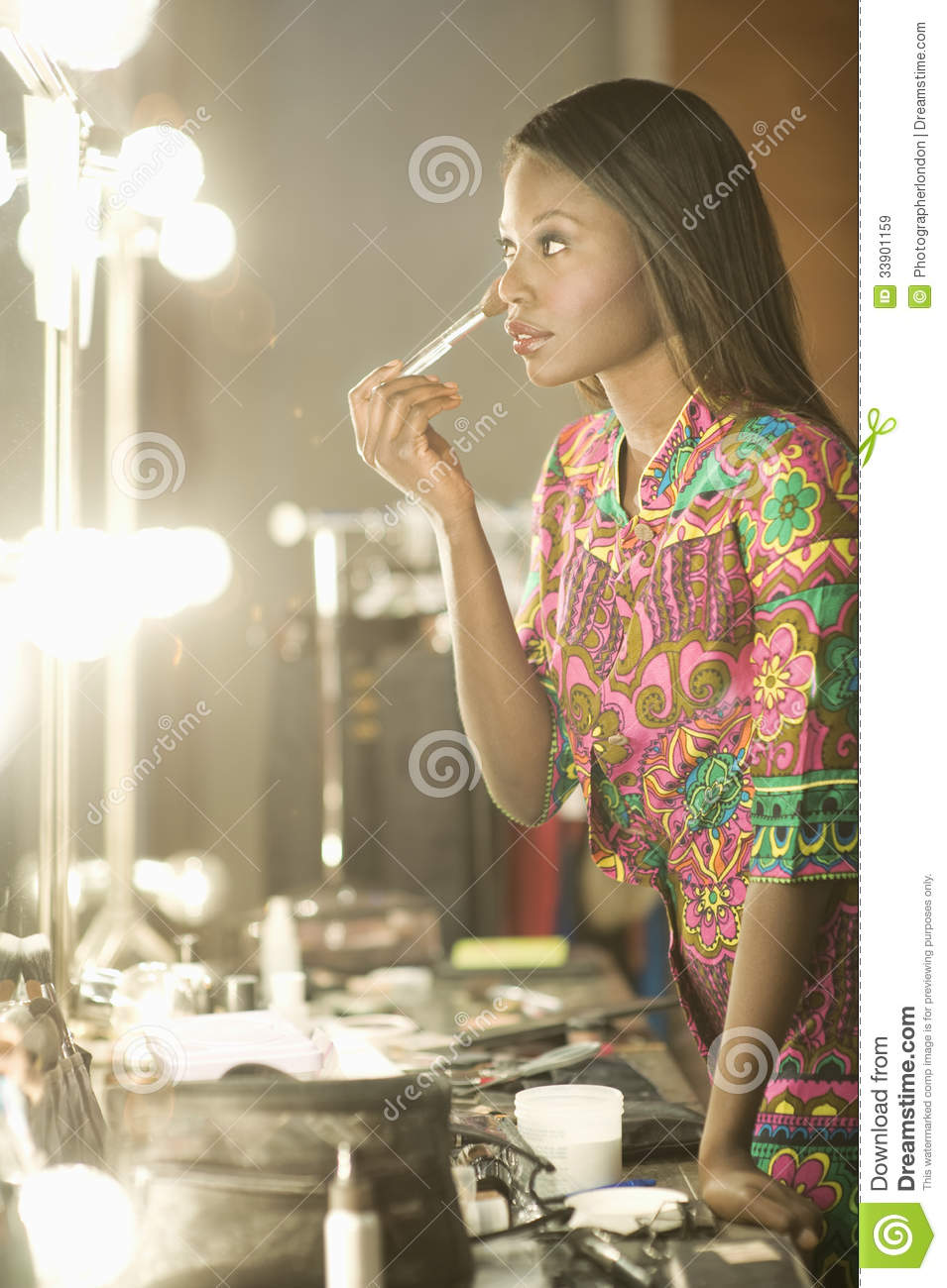 Model Applying Makeup In Dressing Room Royalty Free Stock