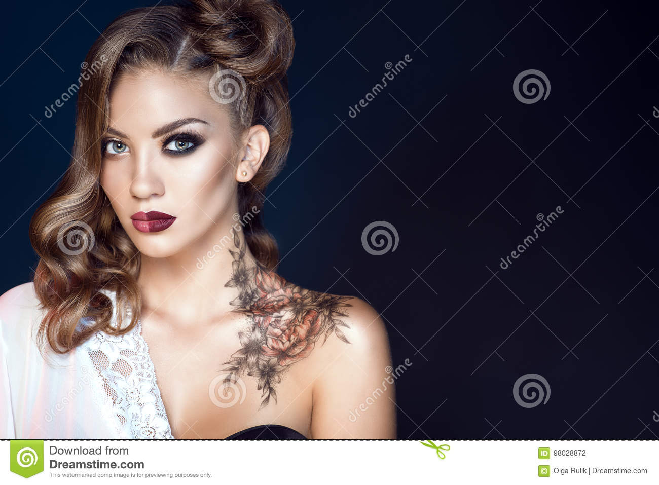 Model with artistic make up and hairstyle. Body art on her shoulder. Ideal woman concept