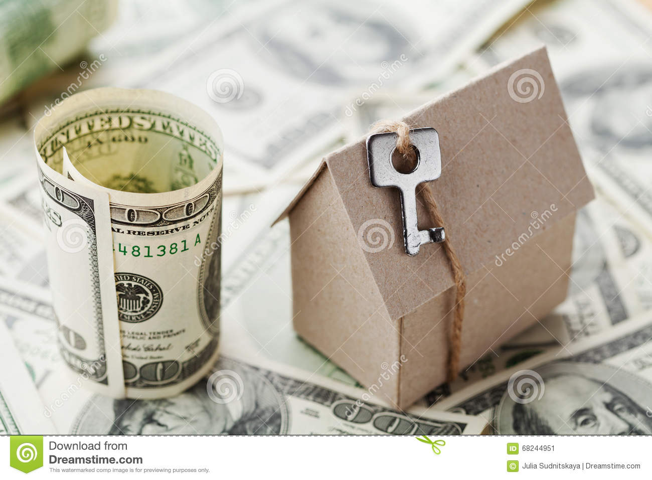 Model cardboard home key and dollar money house building for Money to build a house