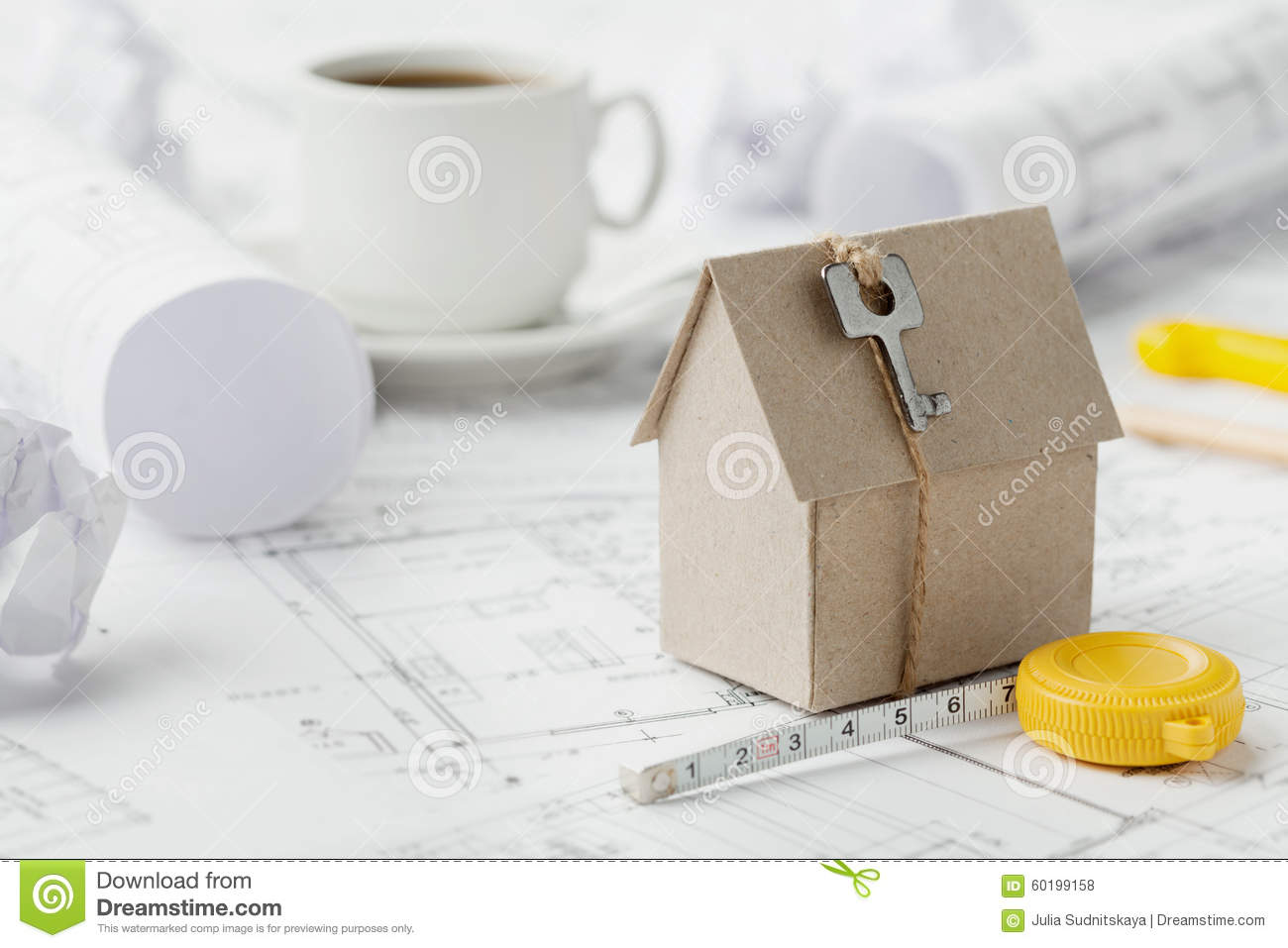 Model cardboard house with key and tape measure on blueprint home download model cardboard house with key and tape measure on blueprint home building architectural malvernweather Images