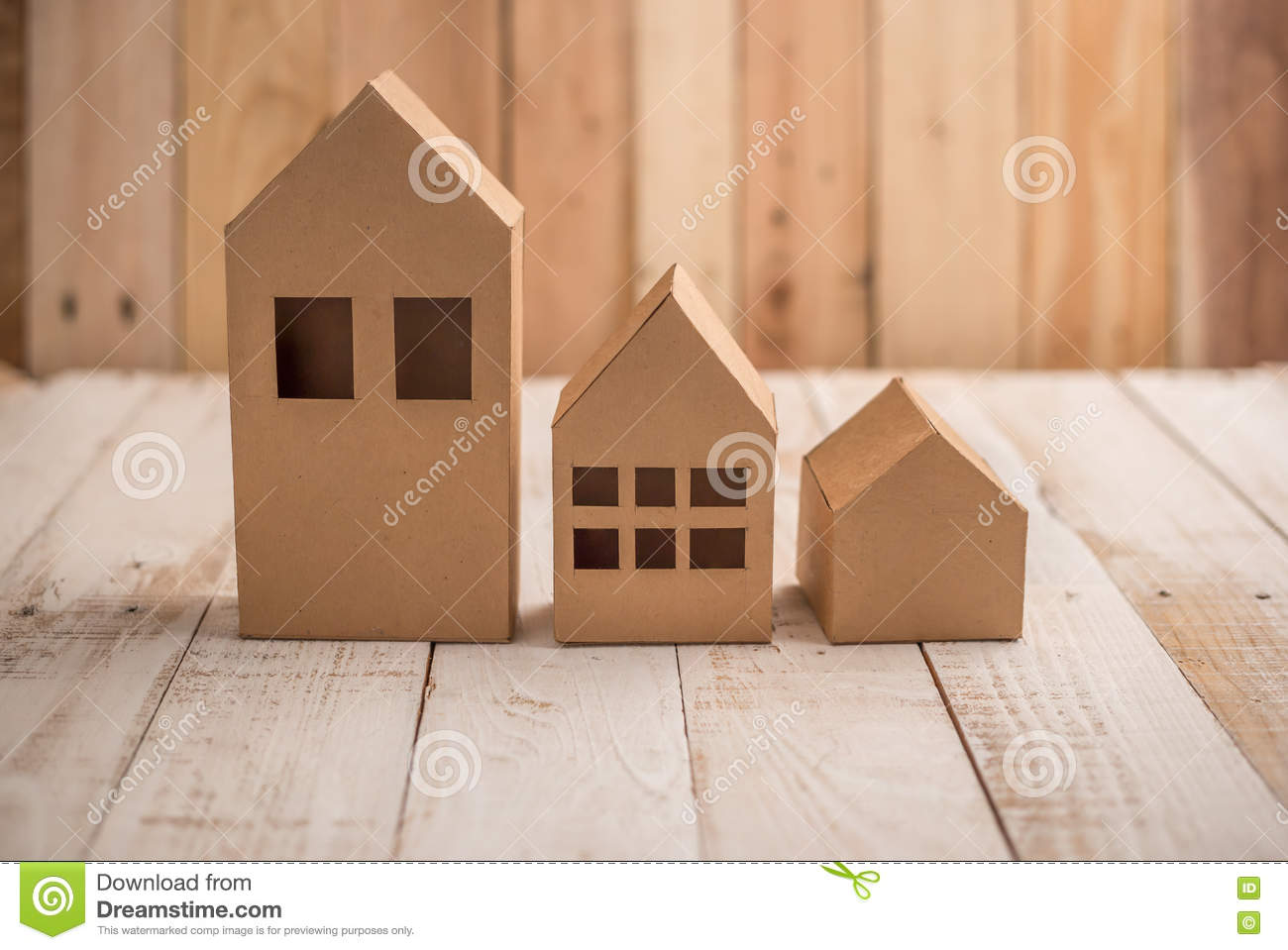 Model Of Cardboard House On Wooden Floor And Background