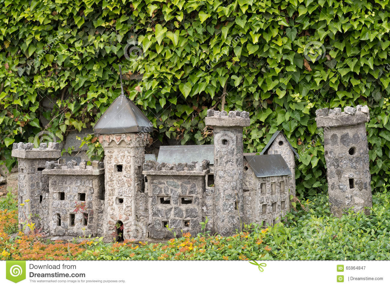 model castle as a decoration in a garden stock photo - image: 65964847
