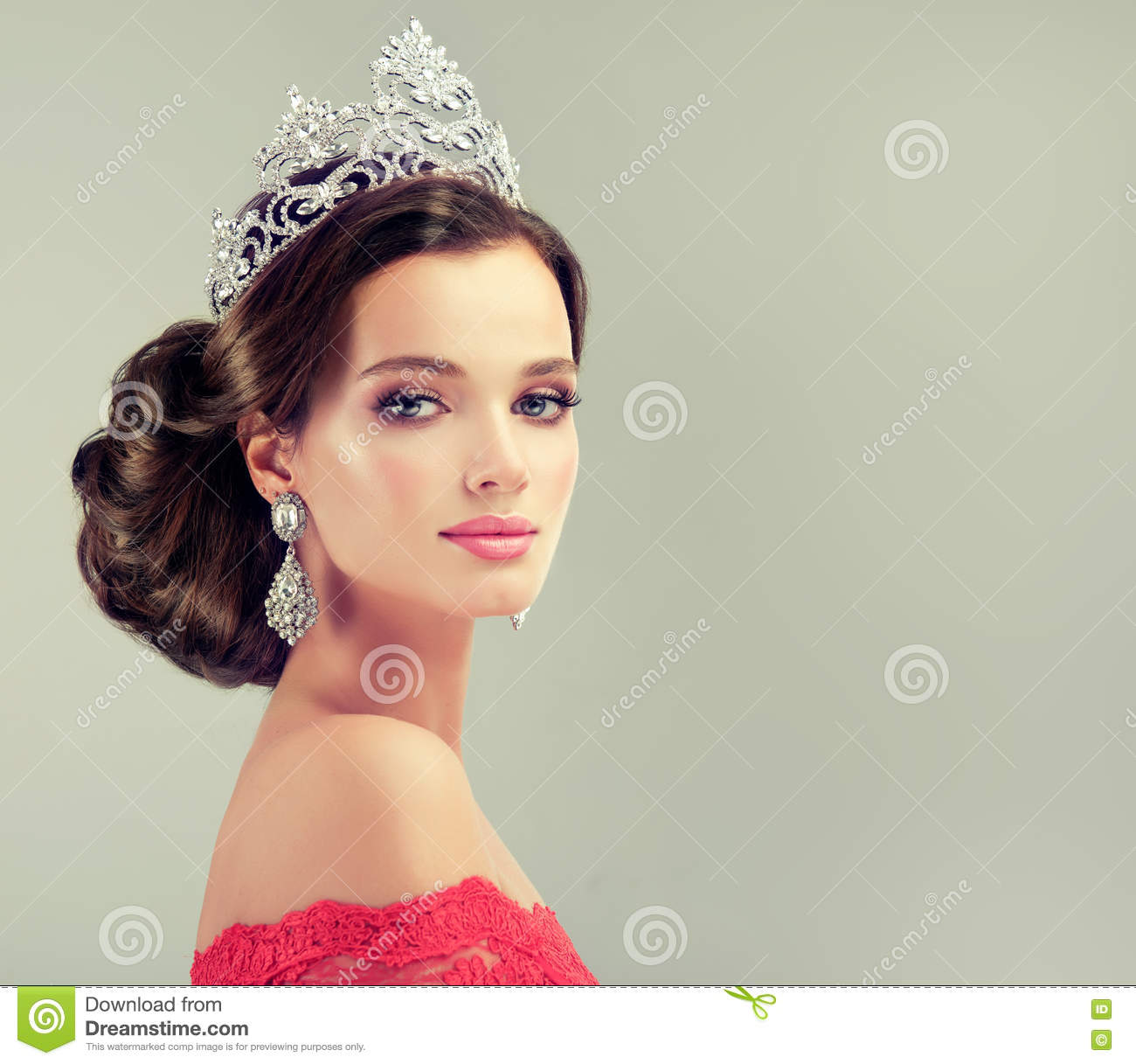 Model In A Delicate Make Up Dressed In A Red Gown And Crown Stock