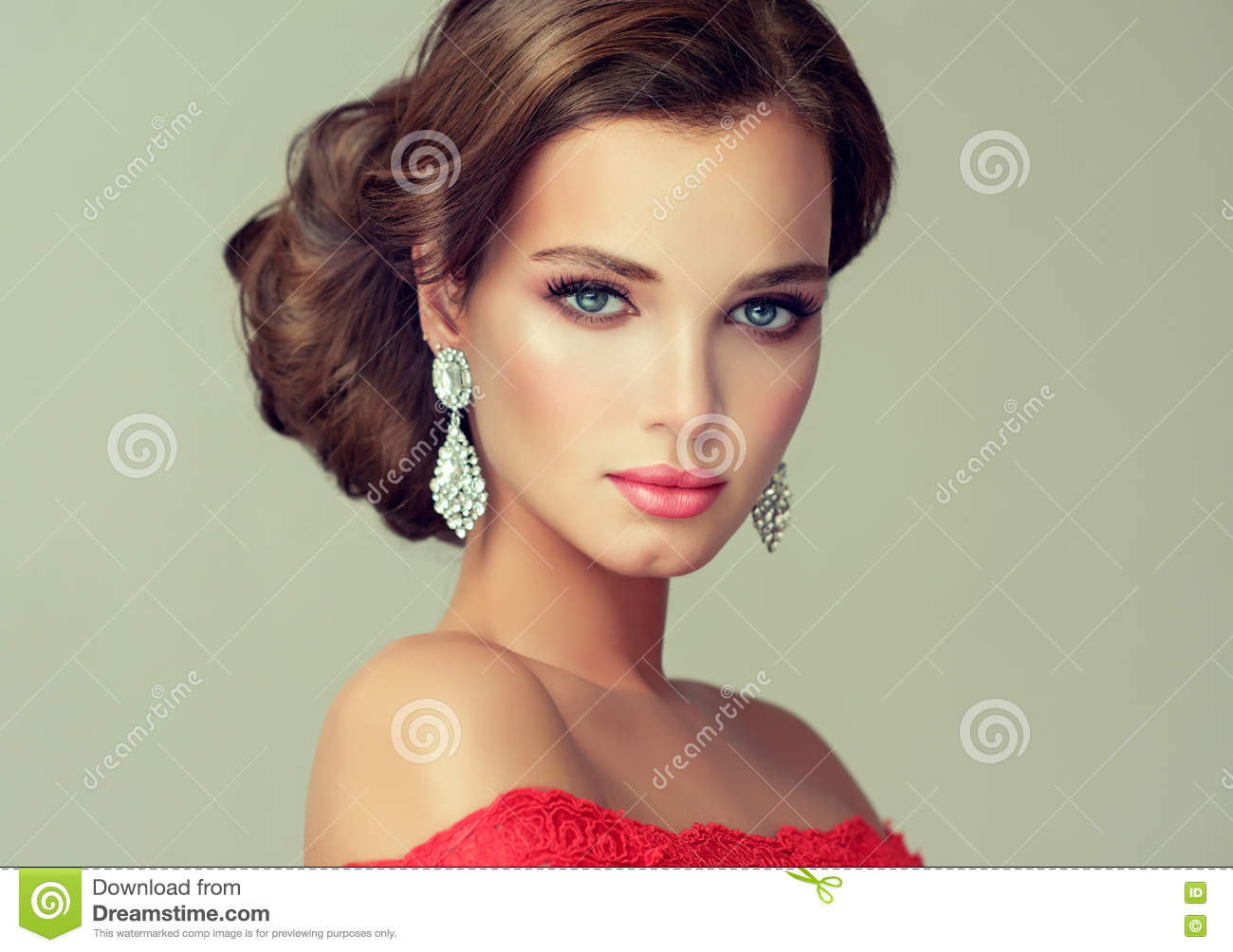 Model In A Delicate Make Up Dressed In A Red Gown Stock Image