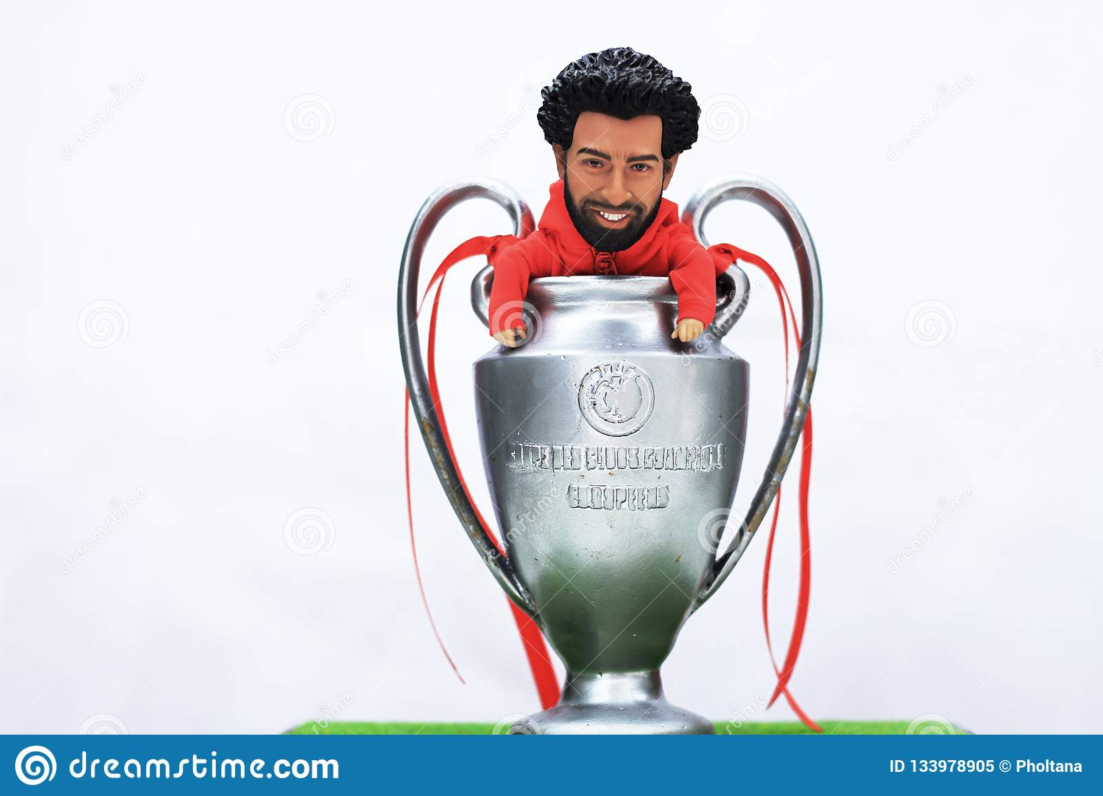 Model Figure Mohamed Salah with Uefa Champions league Trofhy