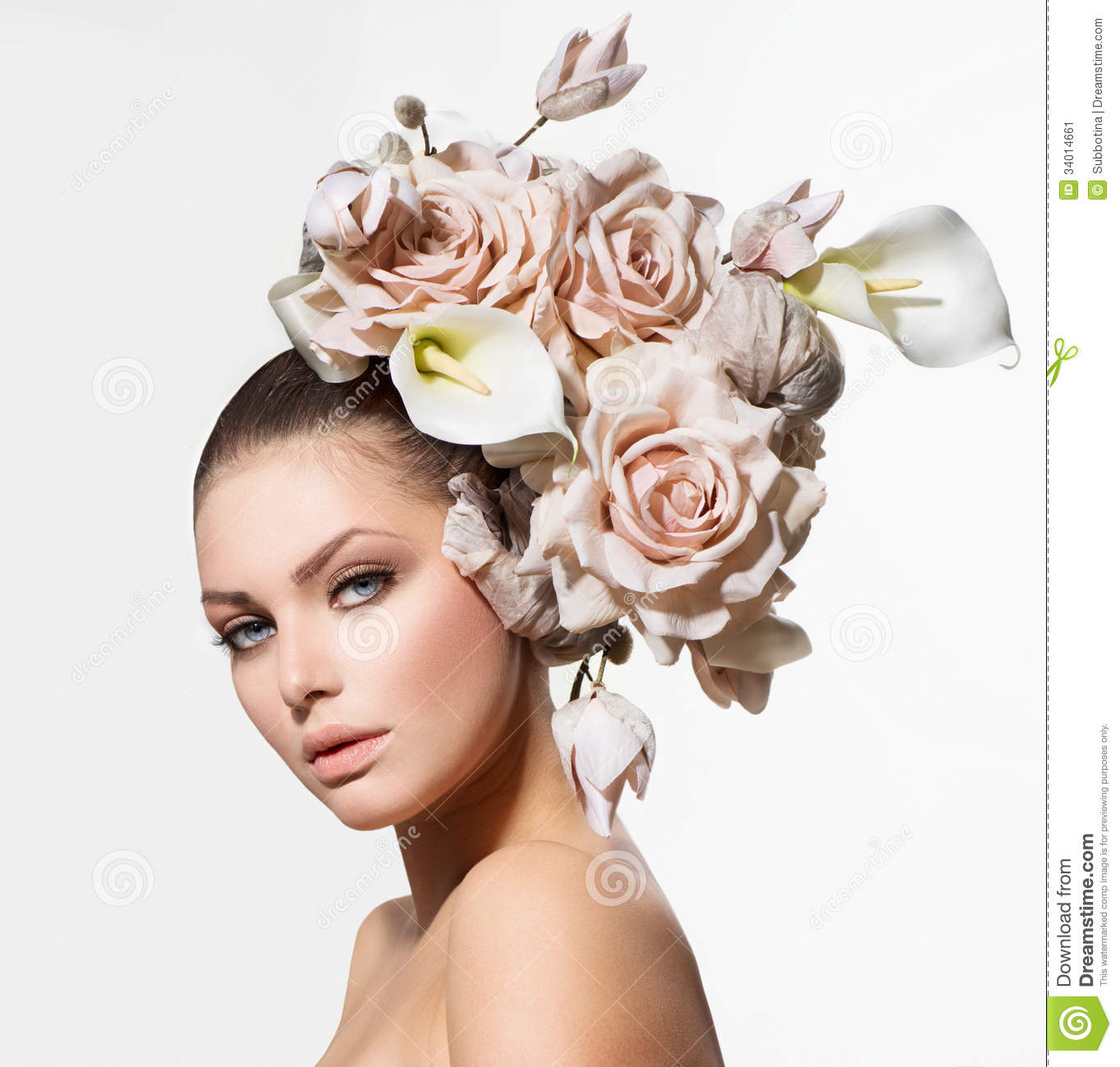Fashion Beauty Girl with Flowers Hair. Bride. Creative Hairstyle.