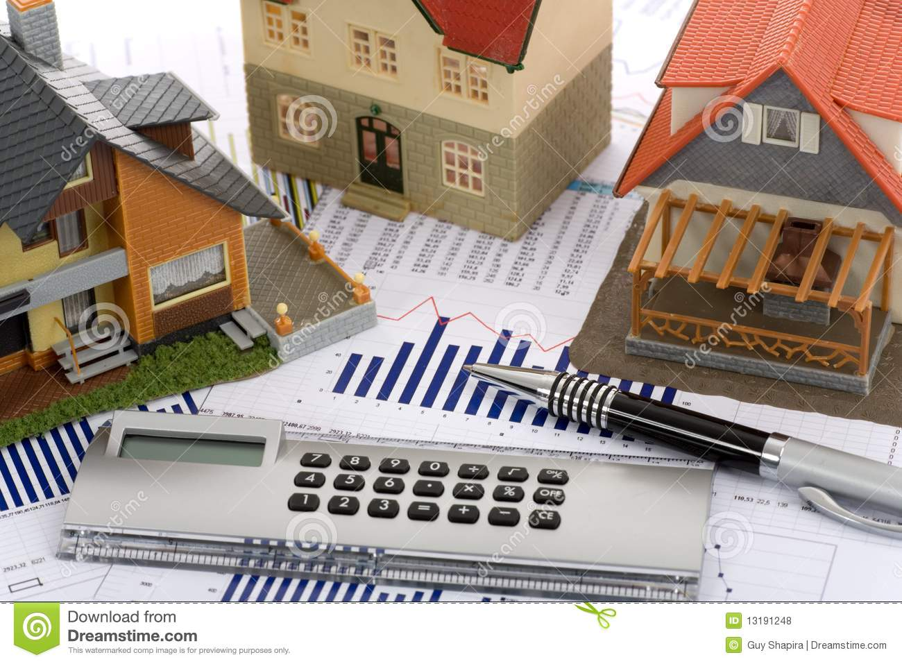Model House And Calculator Royalty Free Stock Photos