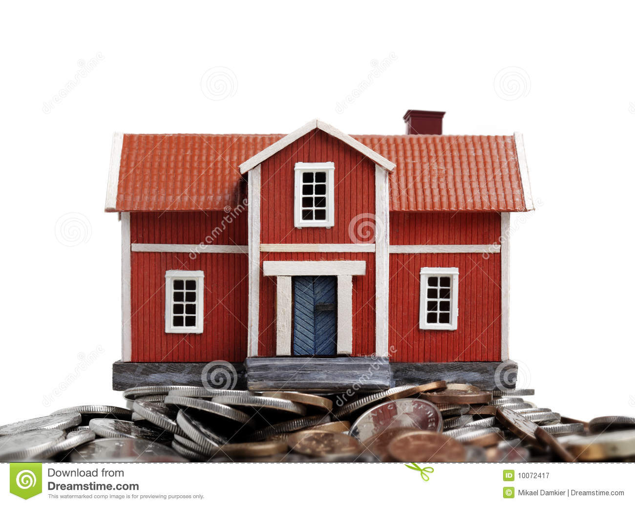 Model of house on pile of coins royalty free stock House piles