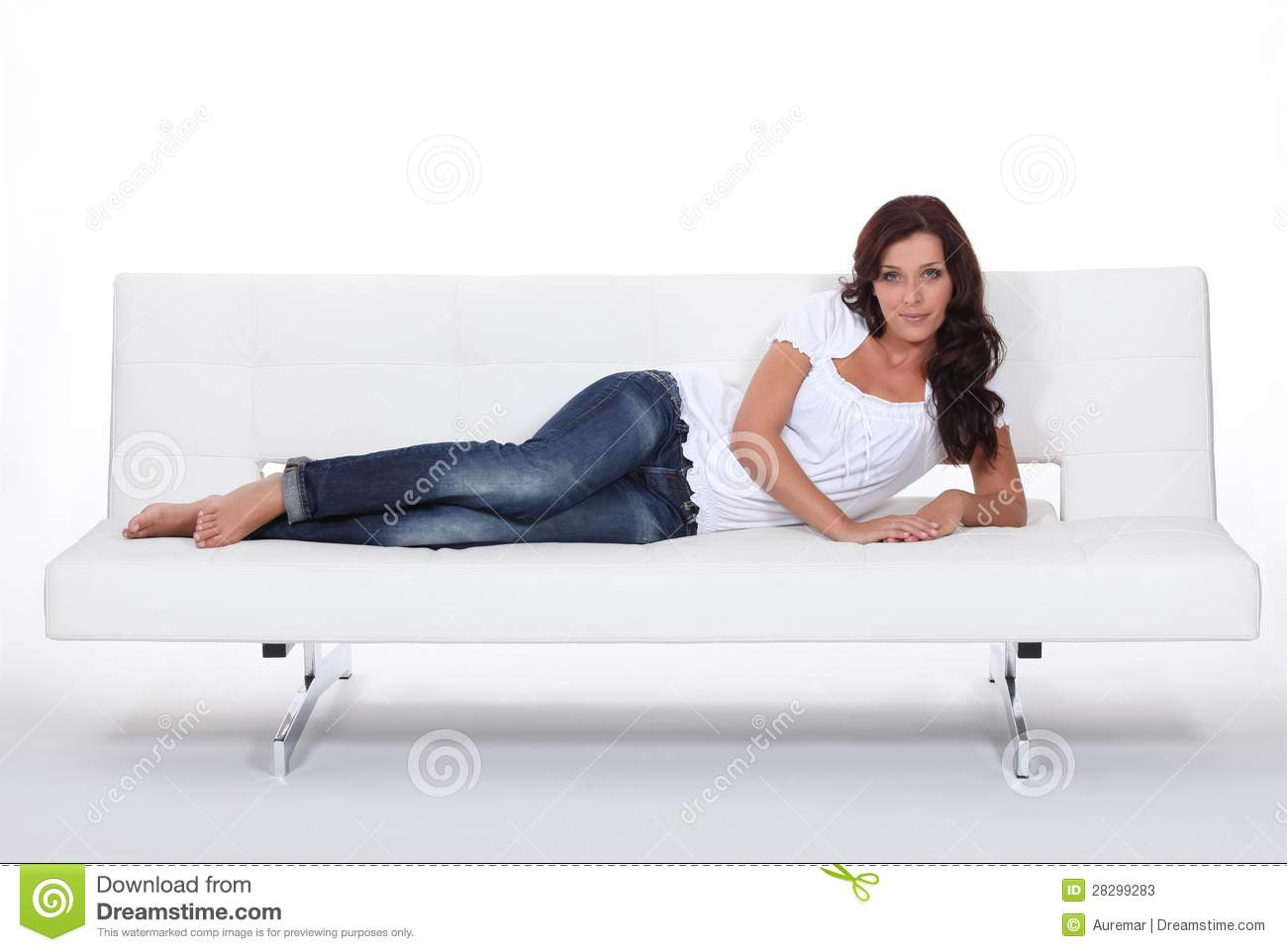 Model Laid On Expensive Sofa Stock Photos - Image: 28299283