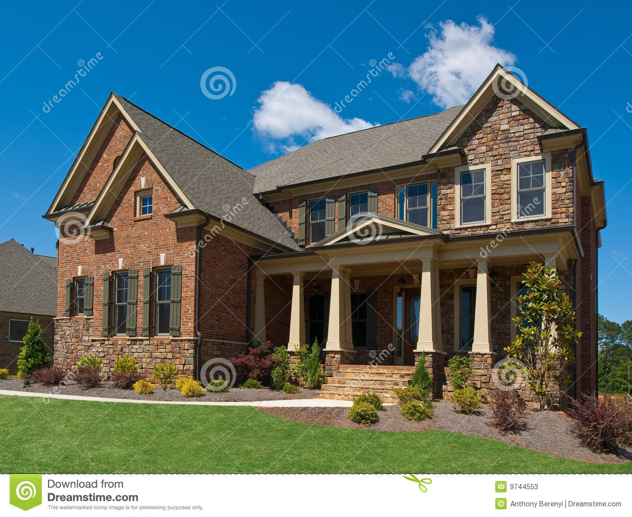 Model luxury home exterior side view columns stock image for Luxury home exterior
