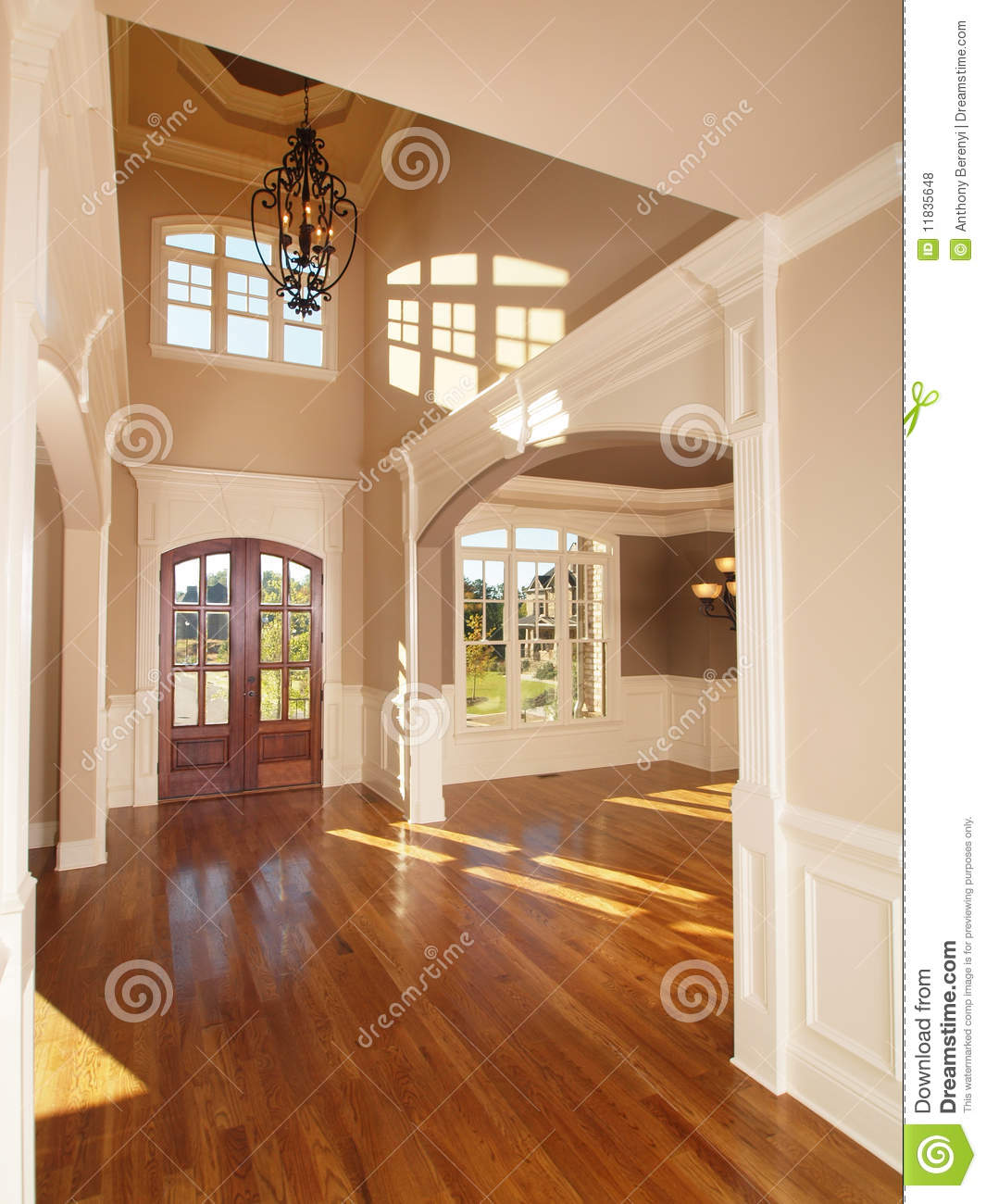 model luxury home interior front entrance archway stock