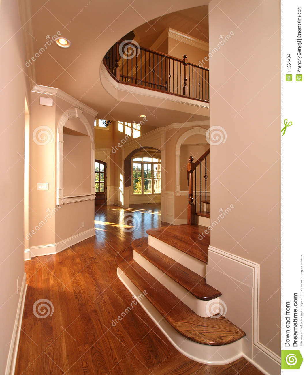 Model luxury home interior hallway with stairs stock photo for Villa de luxe moderne interieur