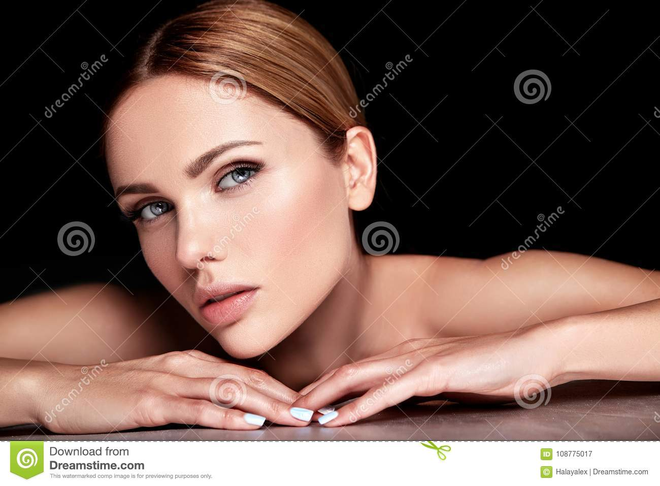 Model with no makeup and clean healthy skin face on black background