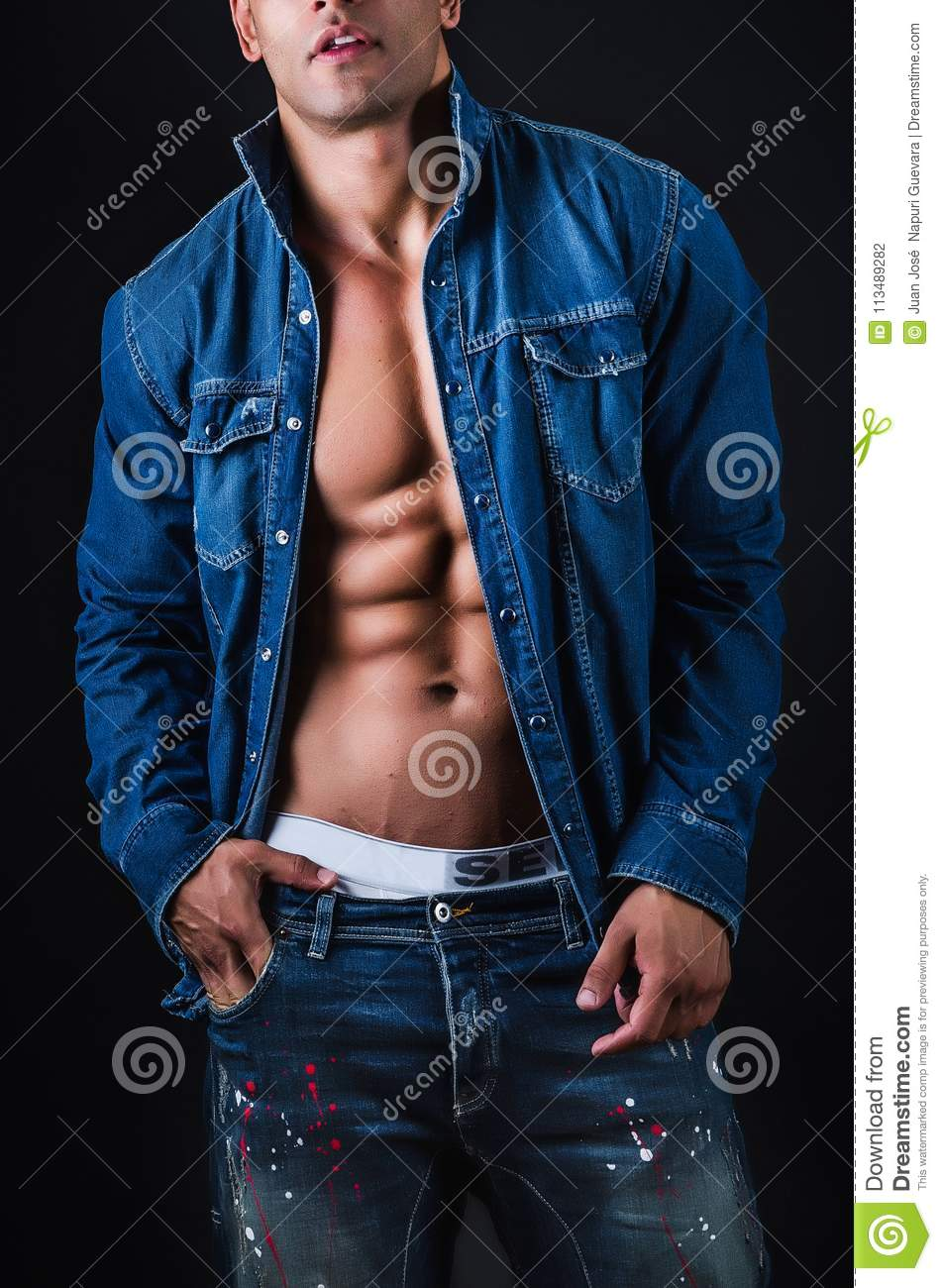 Muscular man with jacket