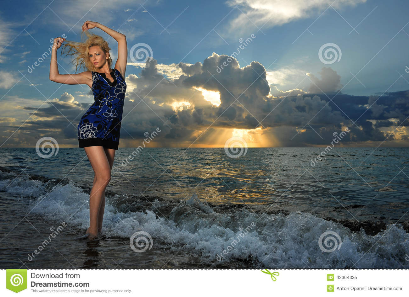 Model posing in beach dress at early morning sunrise