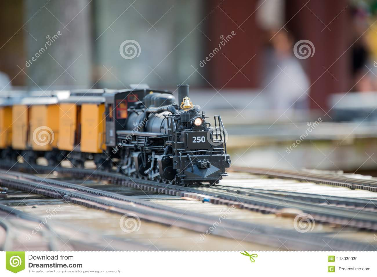 Toy Train on the Track and Model Railroad Exhibit