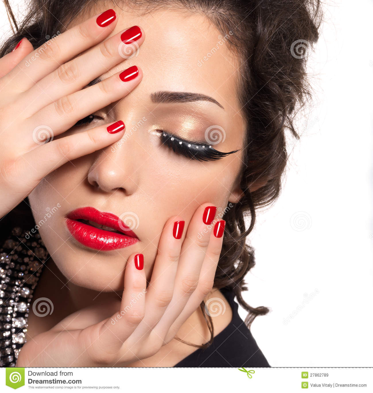 Model With Red Nails, Lips And Creative Eye Makeup Stock