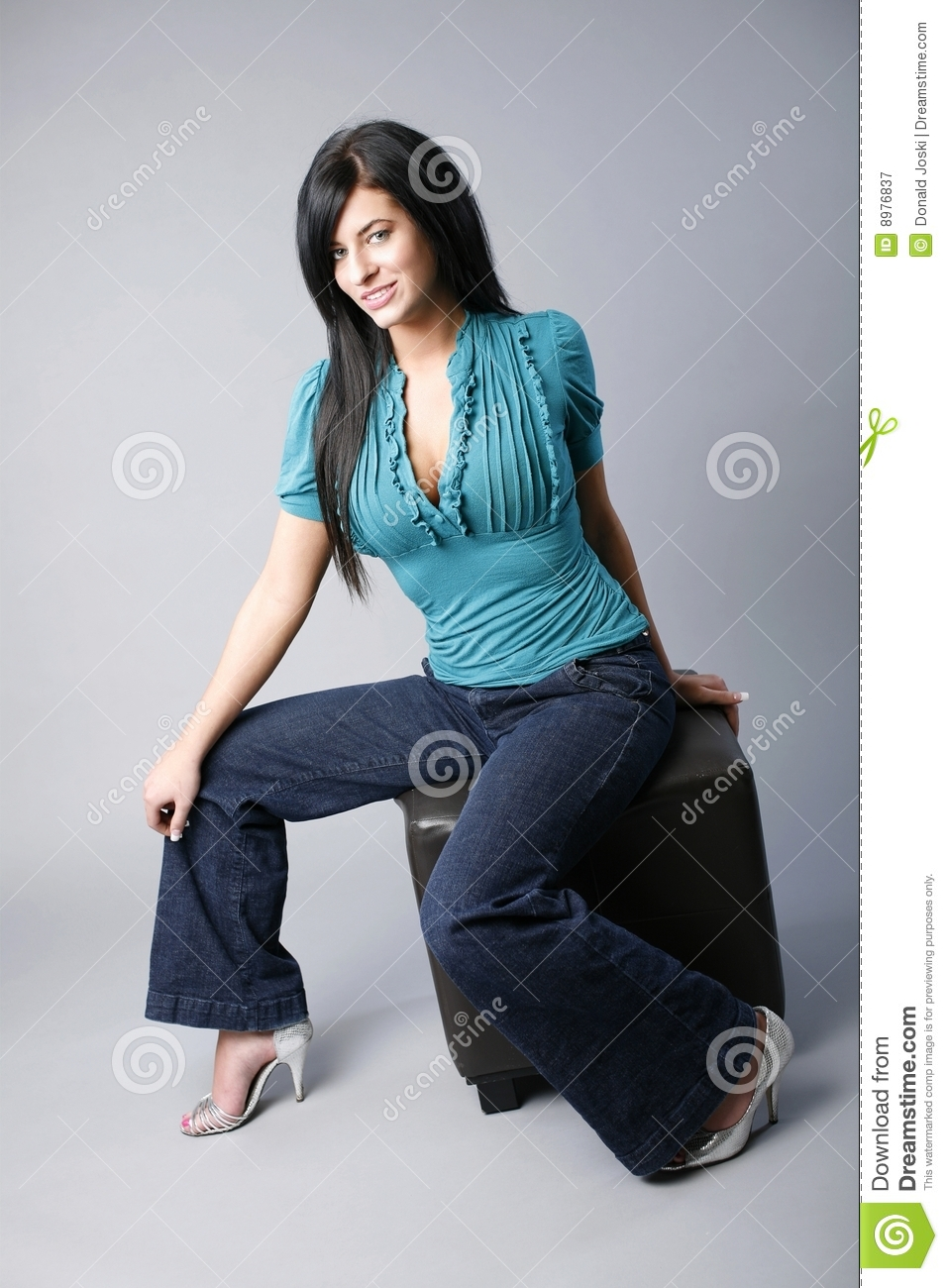 Model sitting on ottoman royalty free stock photography for Ottoman to sit on