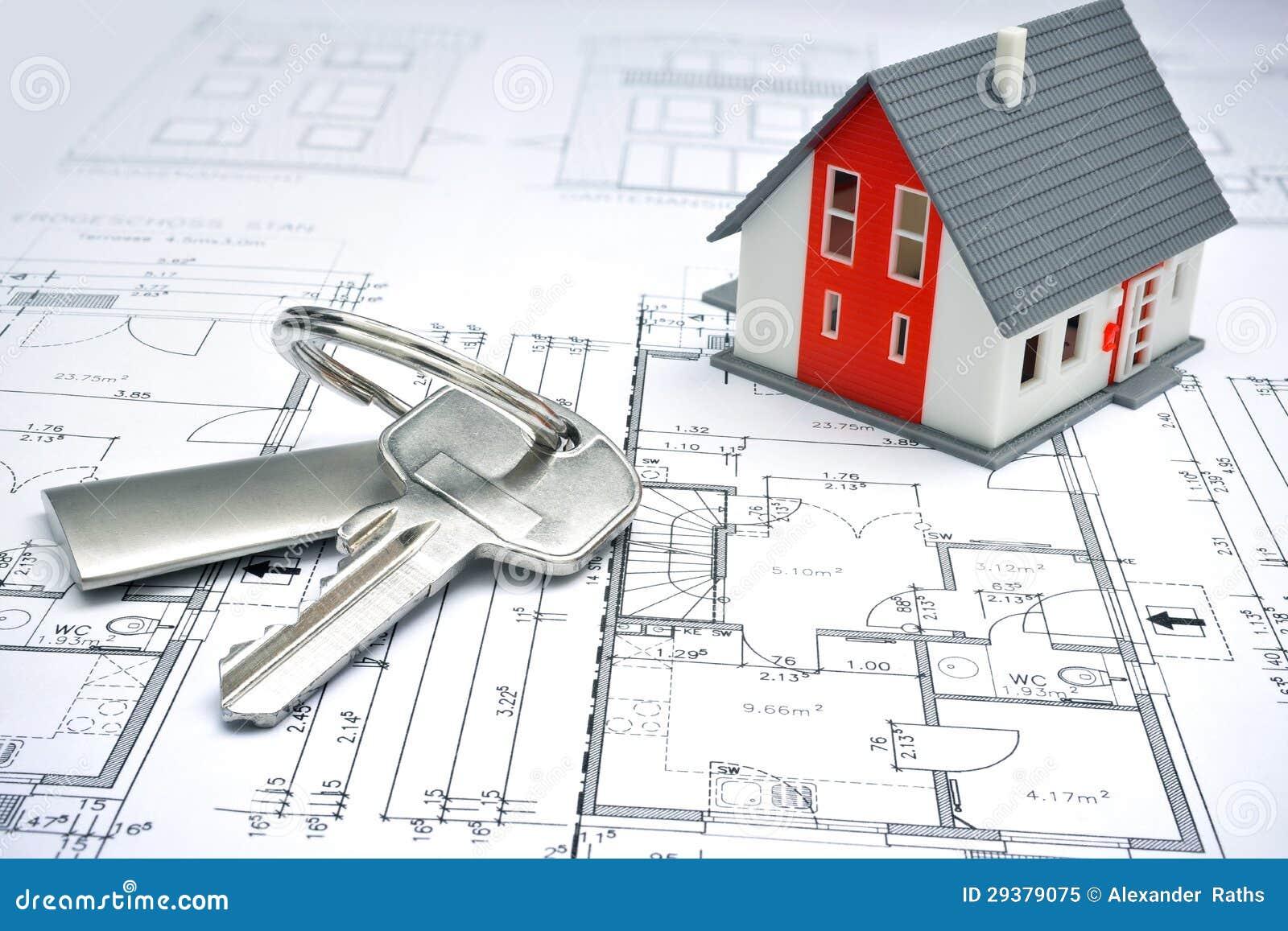 Model van een huis en een sleutelring