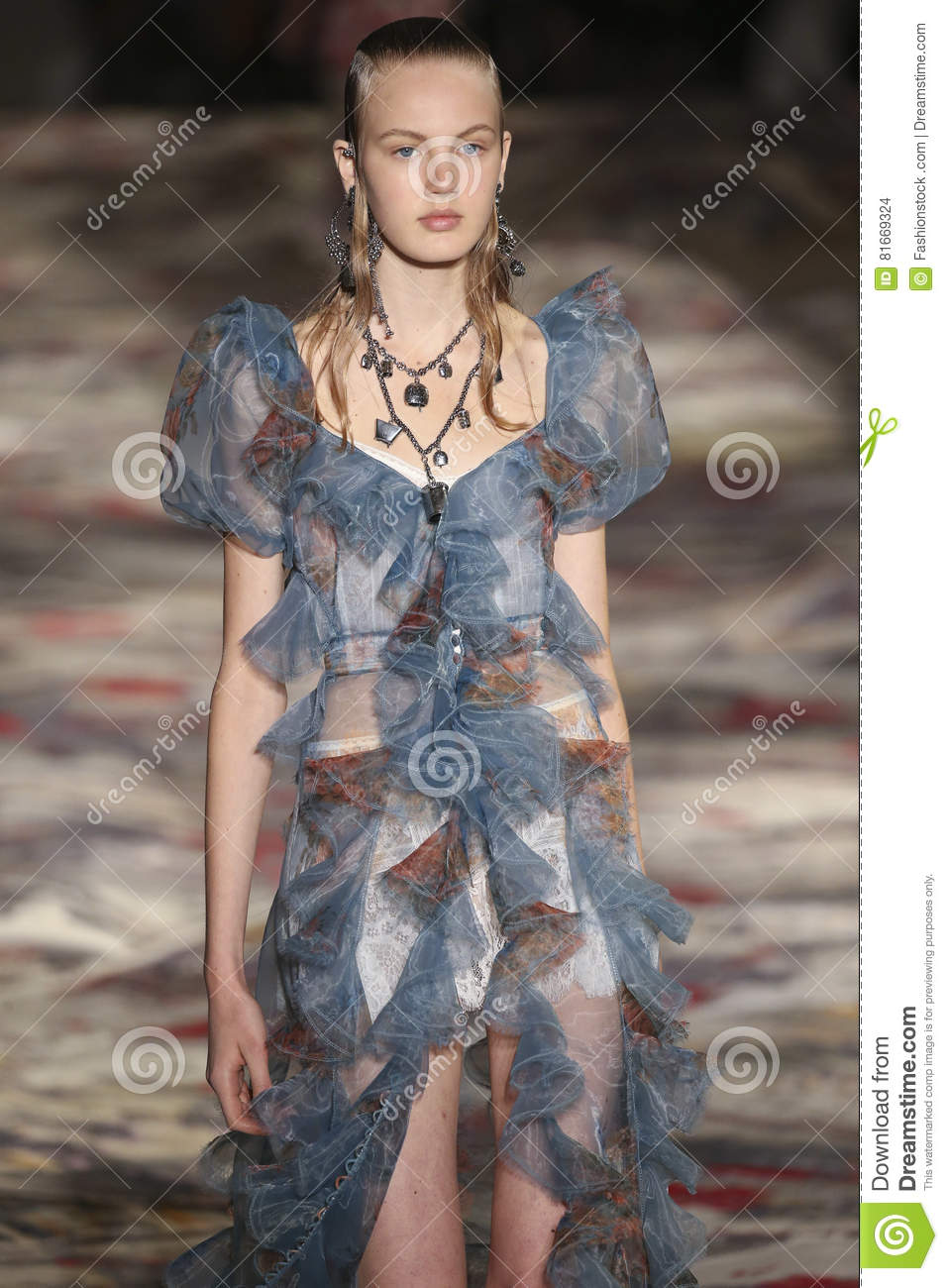 38fb2d090 A Model Walks The Runway During The Alexander McQueen Designed By ...