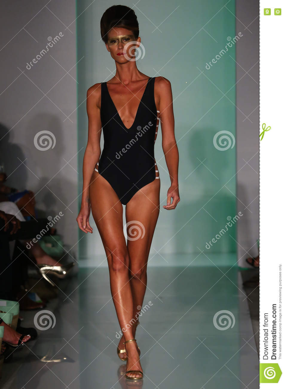 A Model Walks Runway In Designers Swim Apparel At The Mia Marcelle