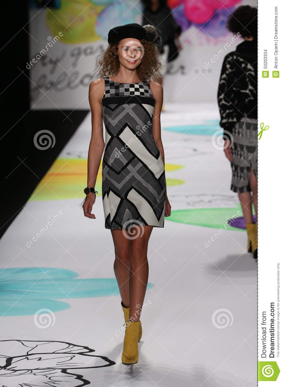 A model walks the runway at the desigual fashion show for Mercedes benz fashion