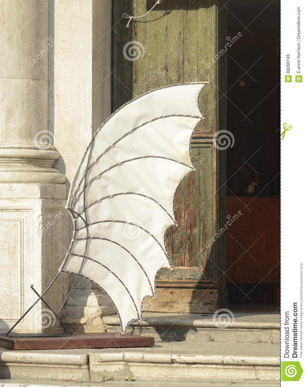 A model of a wing outside a building in Venice.