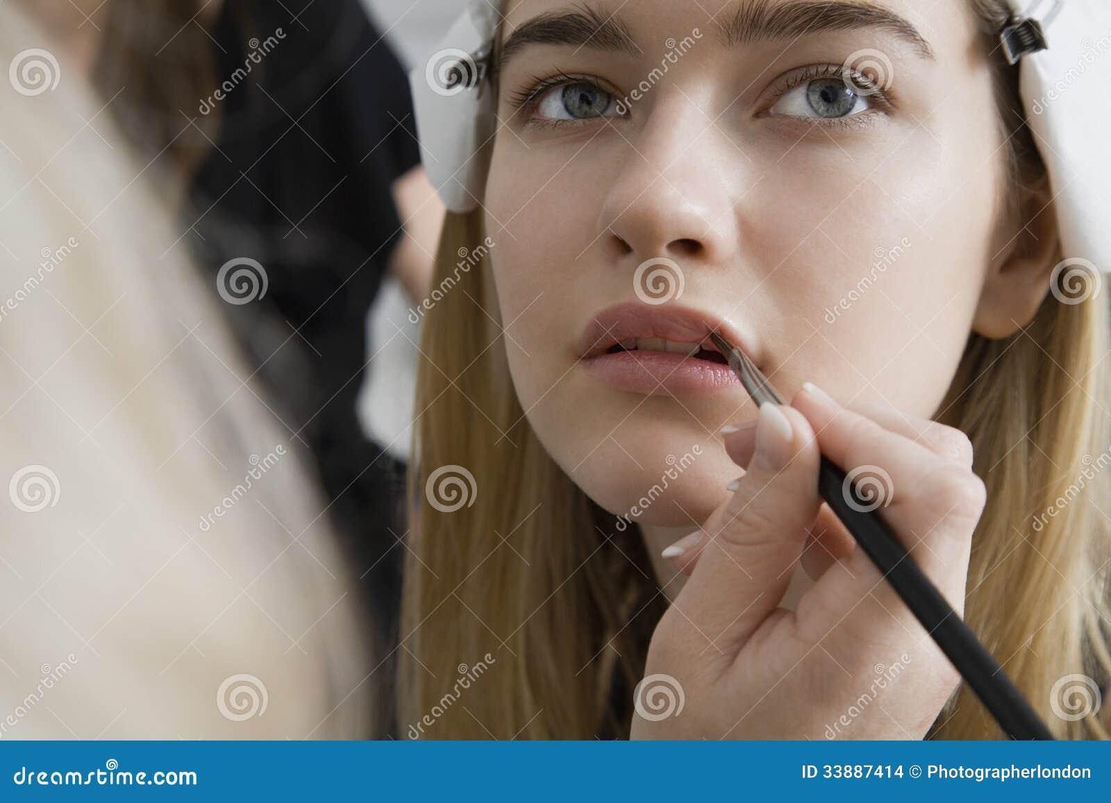 Modell Having Makeup Applied