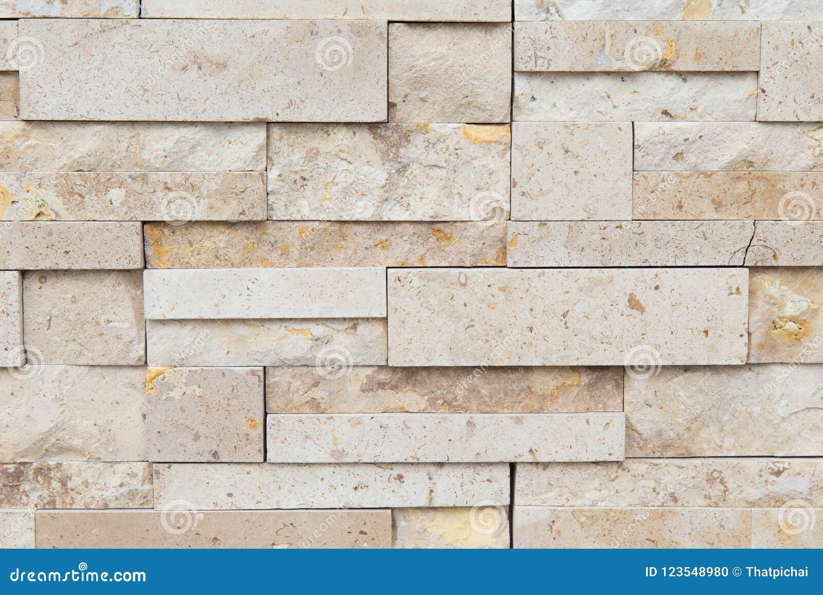 Modellen av dekorativt kritiserar stenväggen för bakgrund