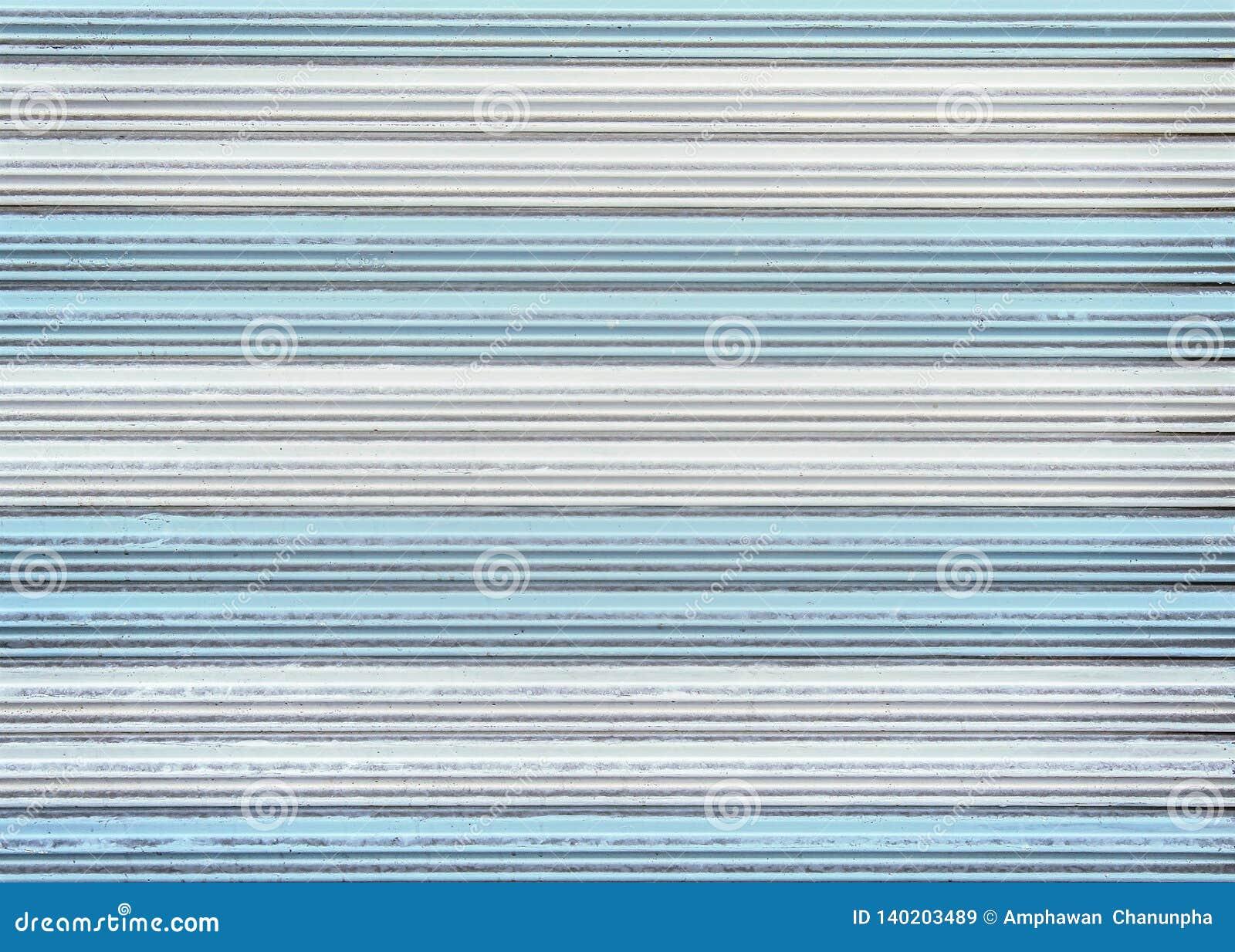 Modeller av färgrik gammal vit och blå textur för rullningsståldörr eller rullslutaredörren för bakgrund