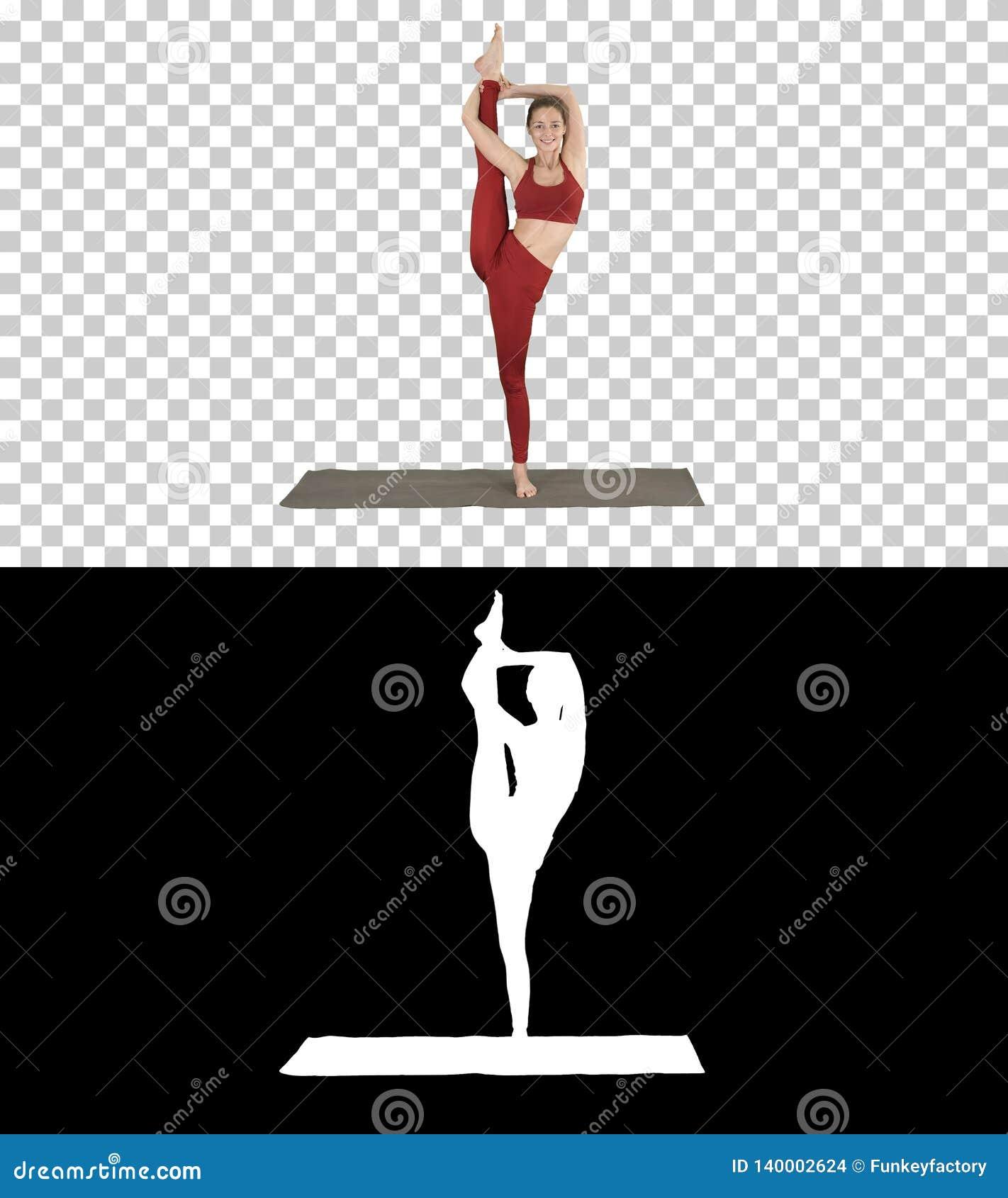 Modelo femenino Making Standing Split que sonríe, Alpha Channel de la yoga