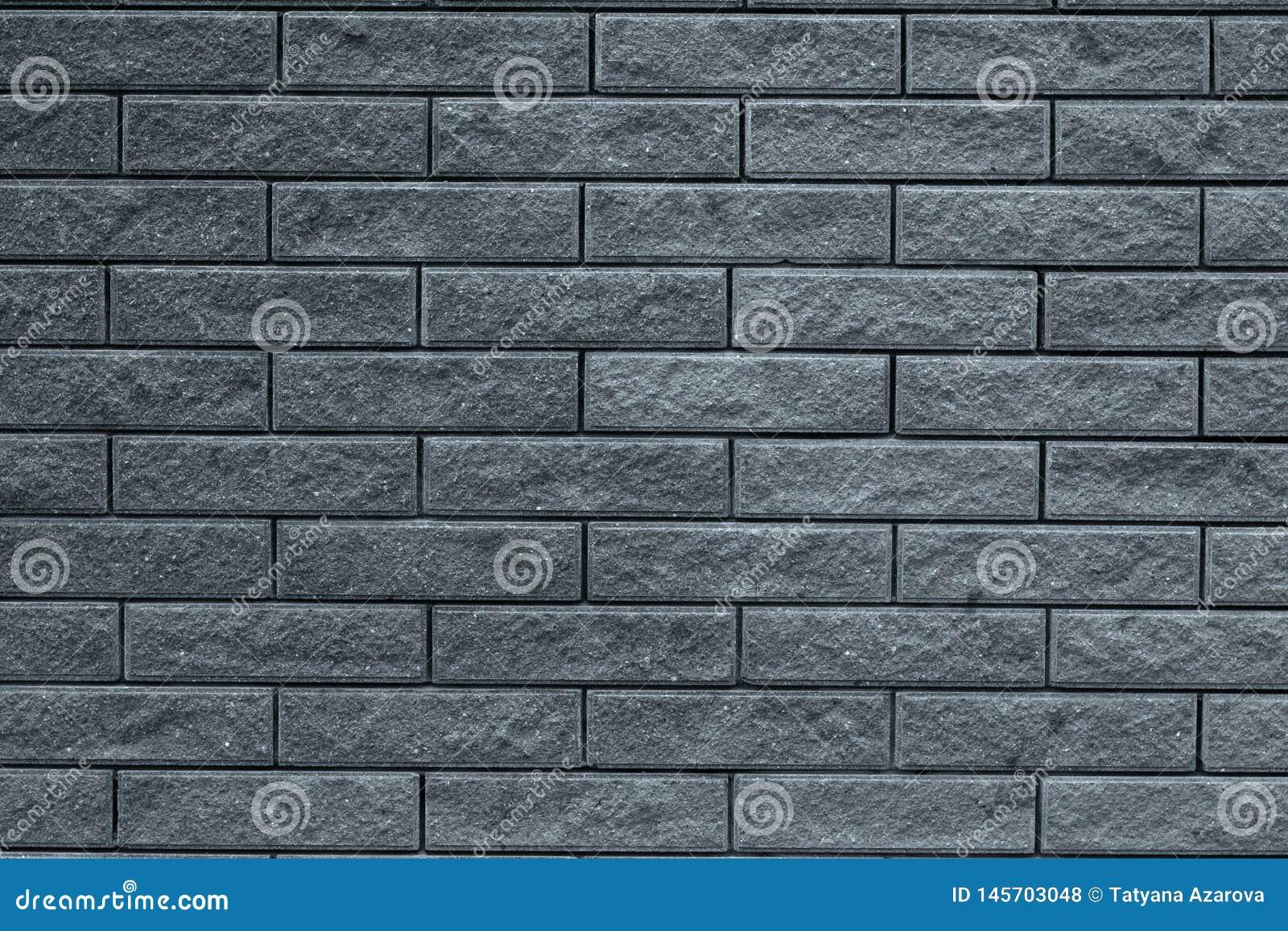 Modelo gris abstracto del fondo de la pared de ladrillo Fondo de piedra gris claro Los ladrillos grises texturizan el contexto de