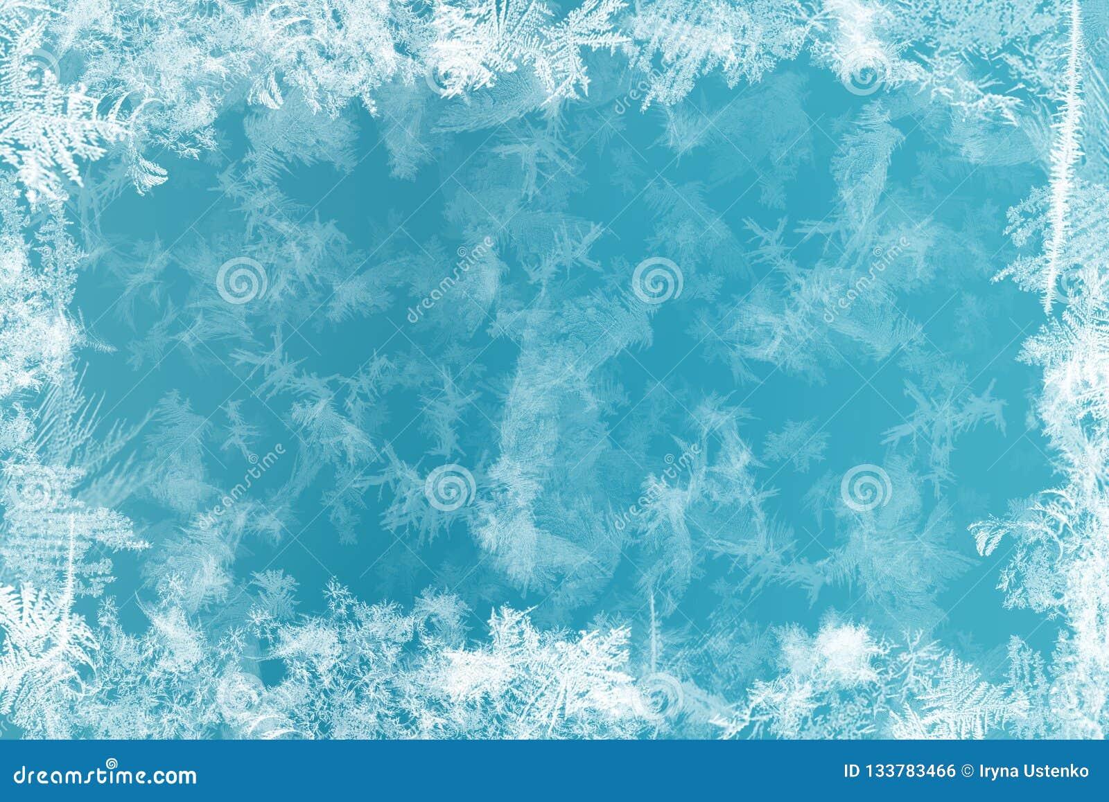 Modelos de Frost en ventana congelada como símbolo de la maravilla de la Navidad Fondo de la Navidad o del Año Nuevo