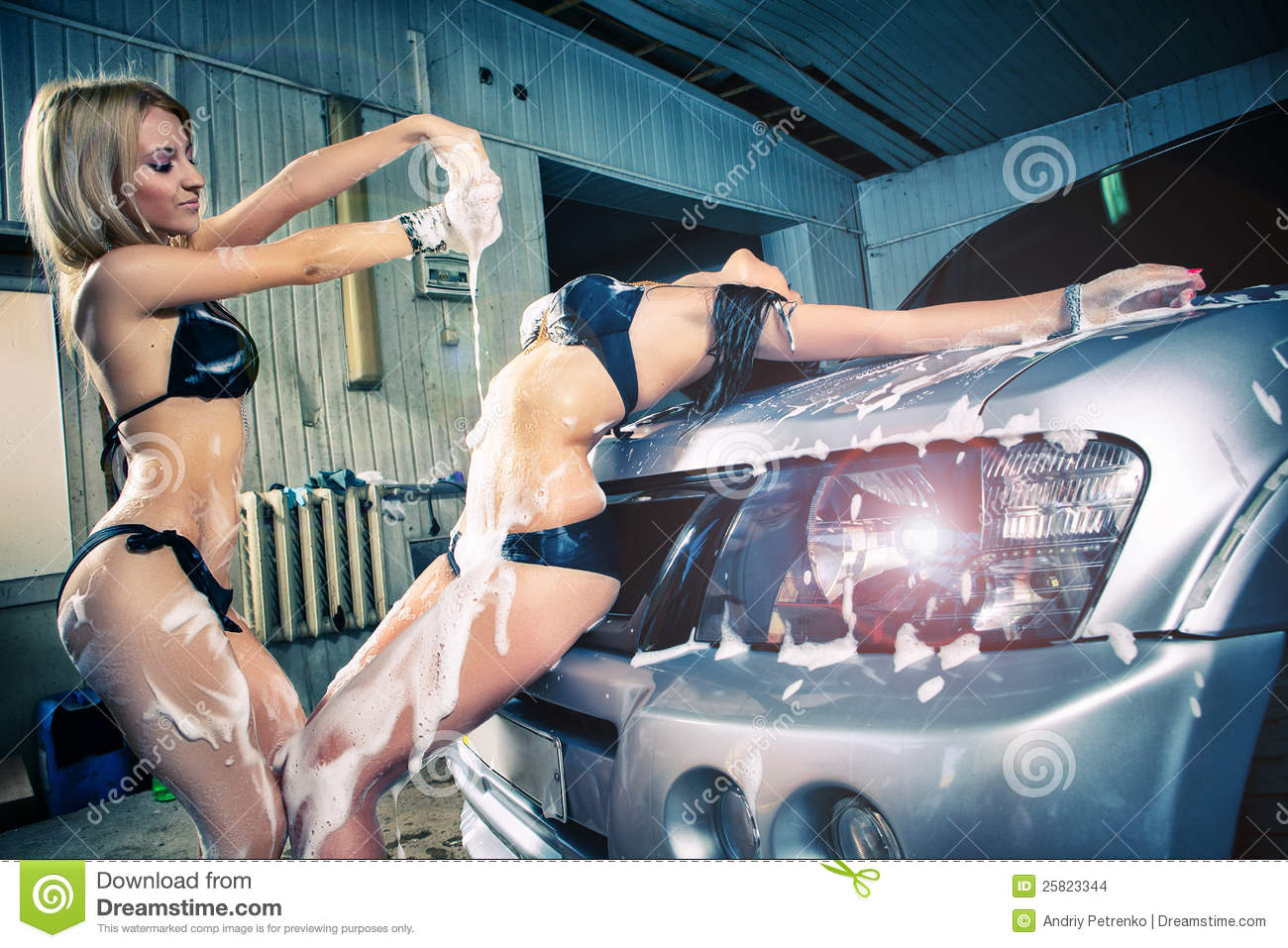 Models At The Car Wash In Garage. Stock Images - Image: 25823344