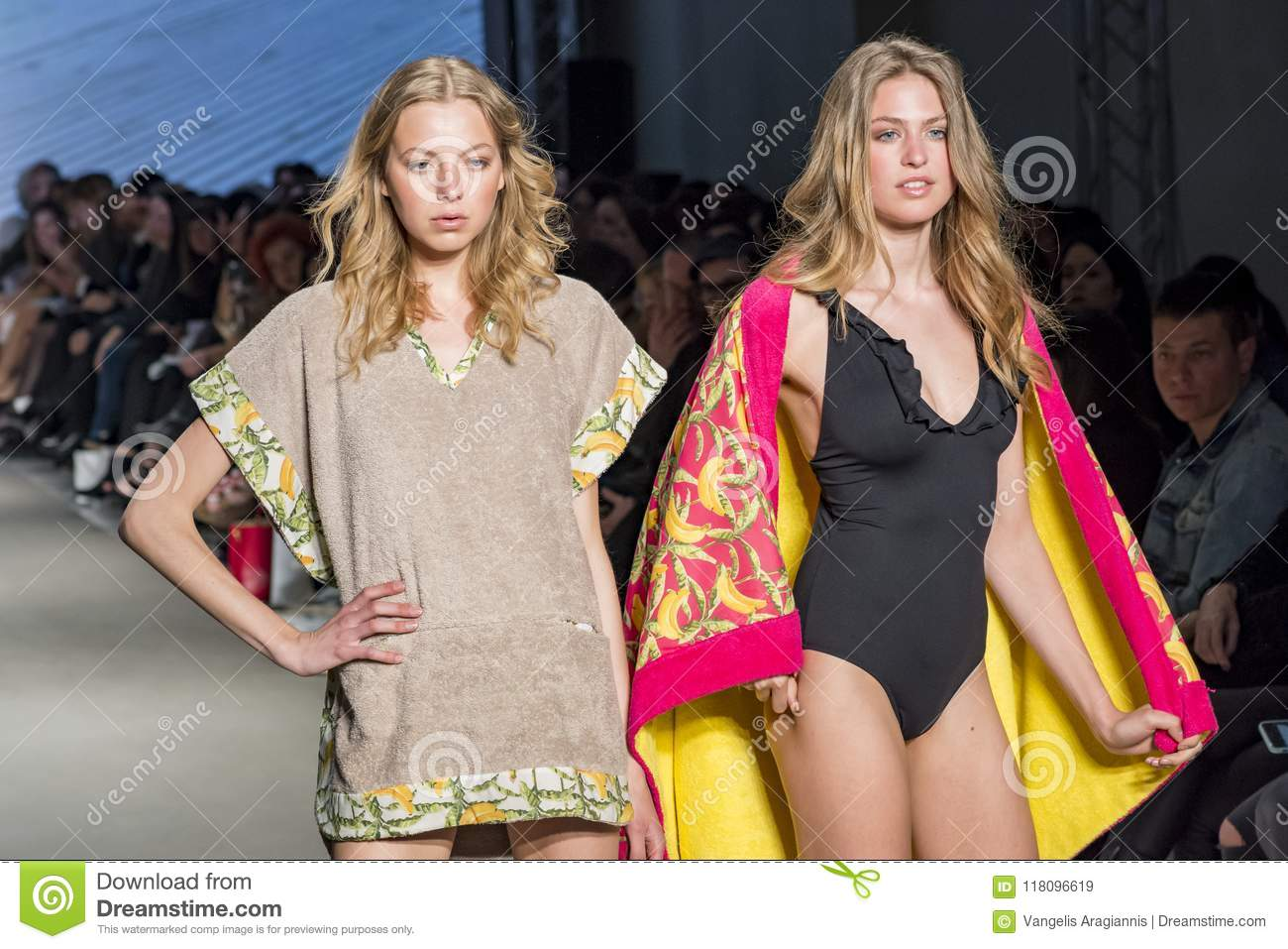 Models with swimsuit posing in fashion show
