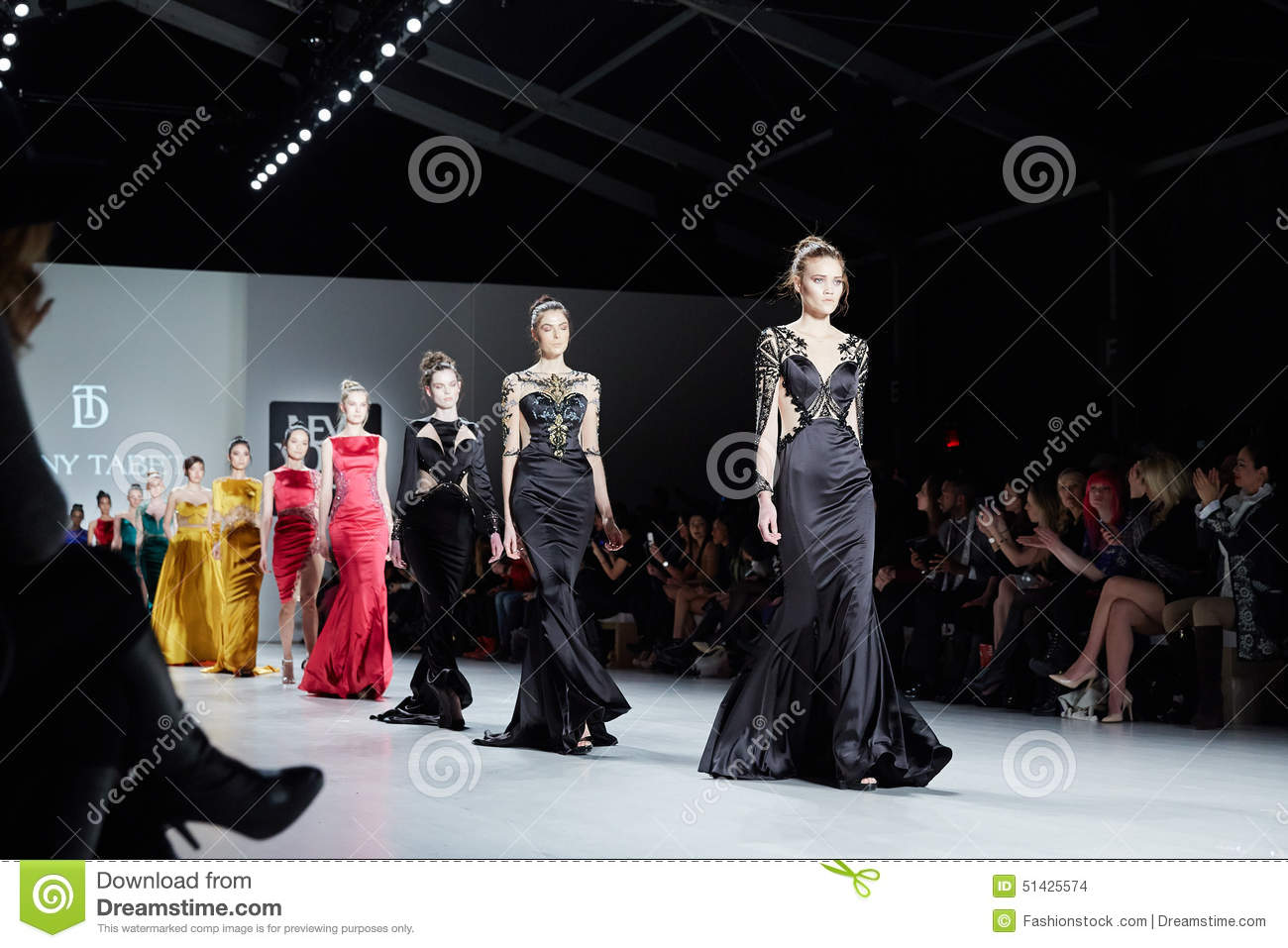 Models walk runway in Dany Tabet dress at the New York Life fashion show during MBFW Fall 2015