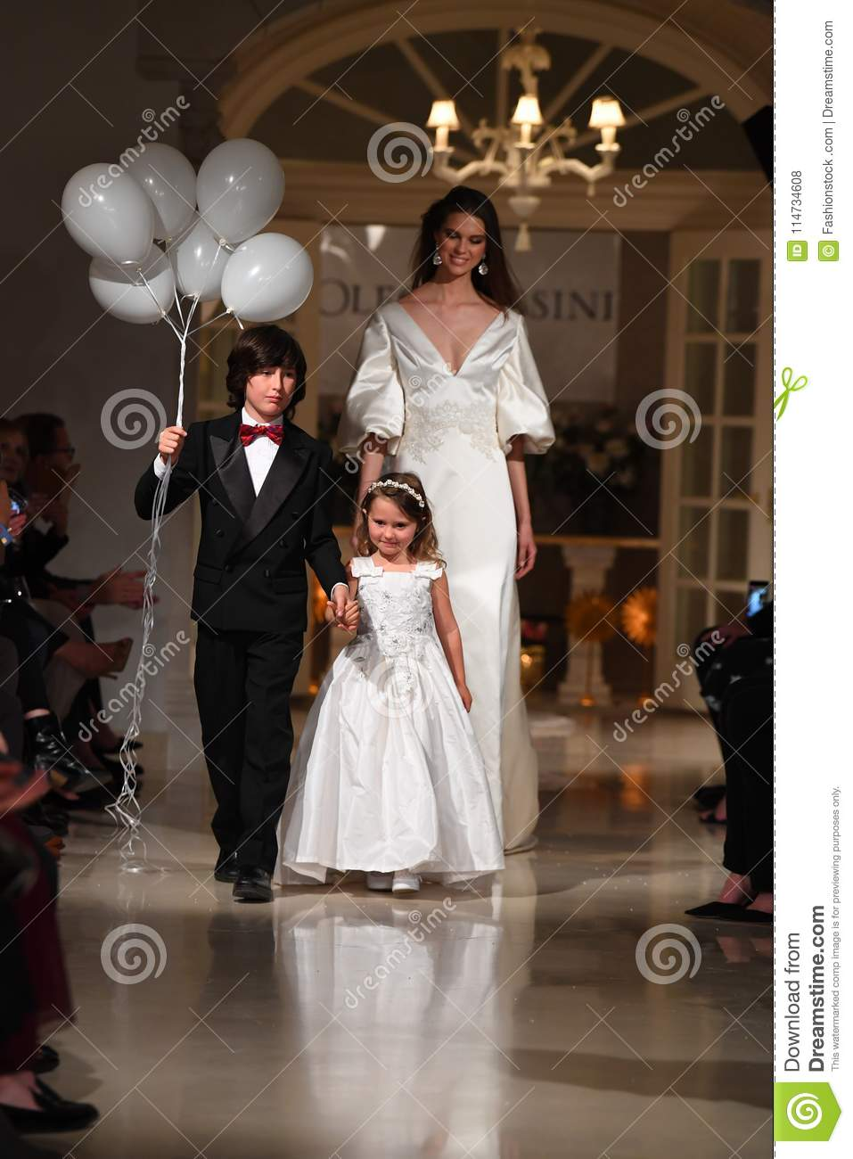 1ce1b42a0f6 Models walk the runway finale during the Oleg Cassini Spring 2019 Bridal  fashion show