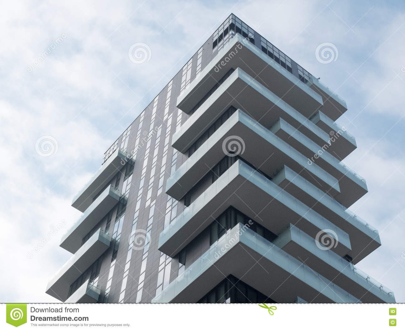 modern apartment building with corner balconies stock