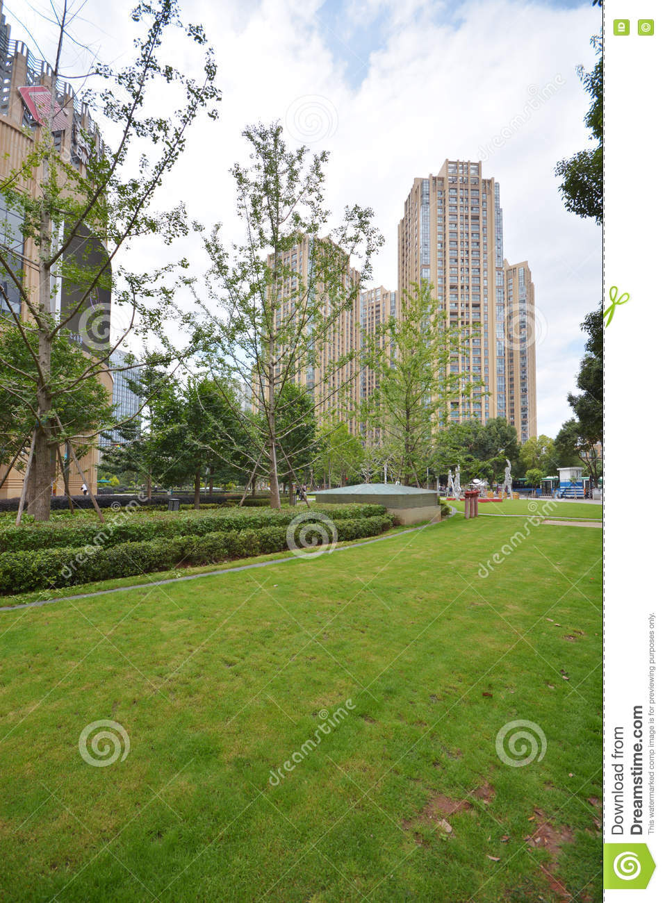 Modern apartment building with green grass