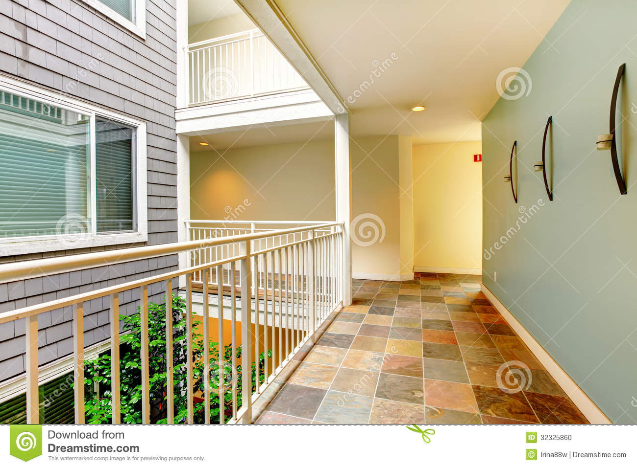 Modern Apartment Building Hallway And Door Near Railing Stock