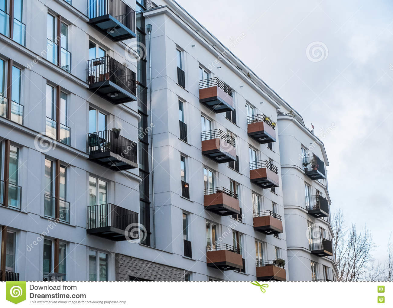 Modern apartment building with small balconies stock photo for Building balcony