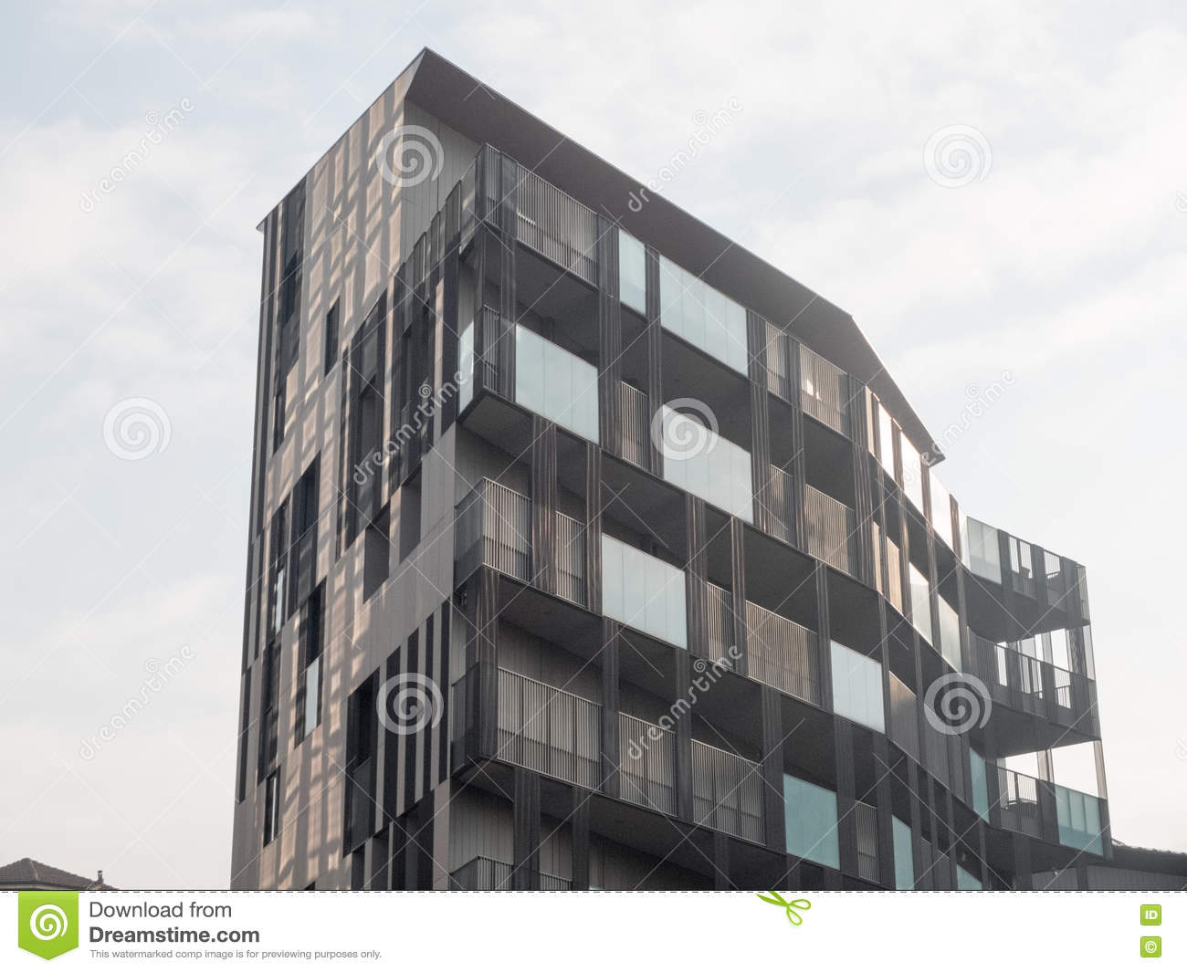 Modern Apartment Building modern apartment building with wavy exterior stock photo - image