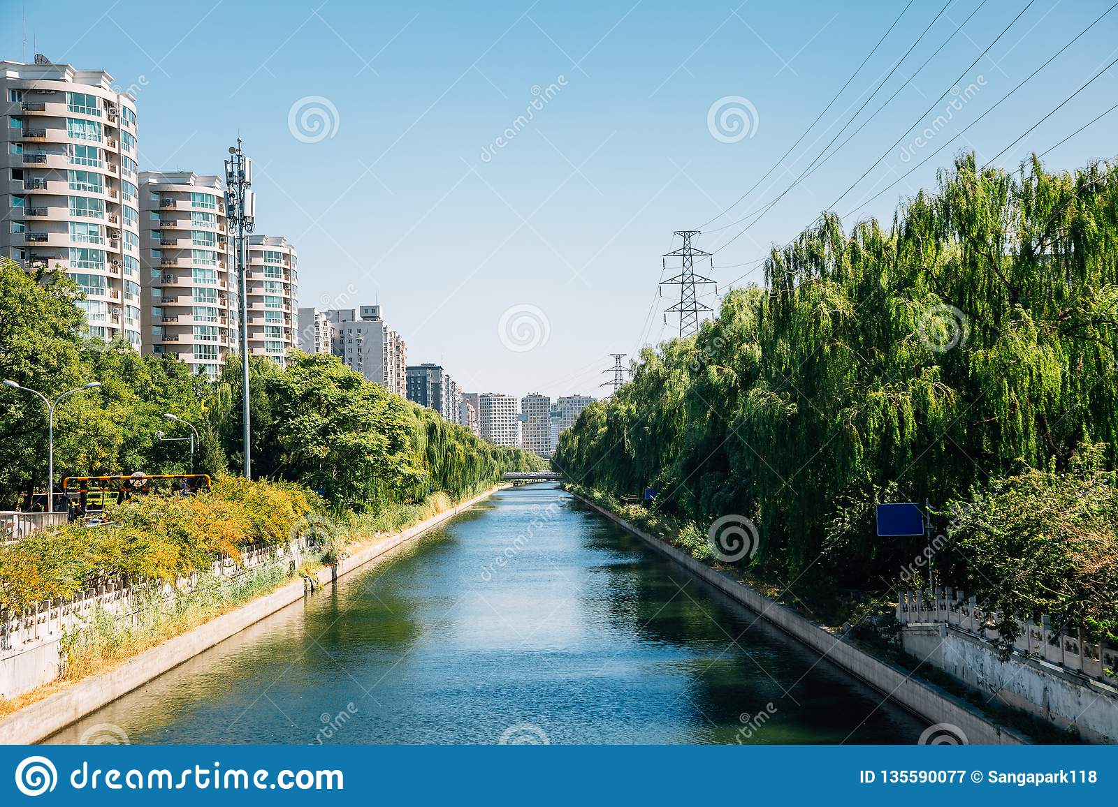 Modern apartment buildings and riverside park in Beijing, China
