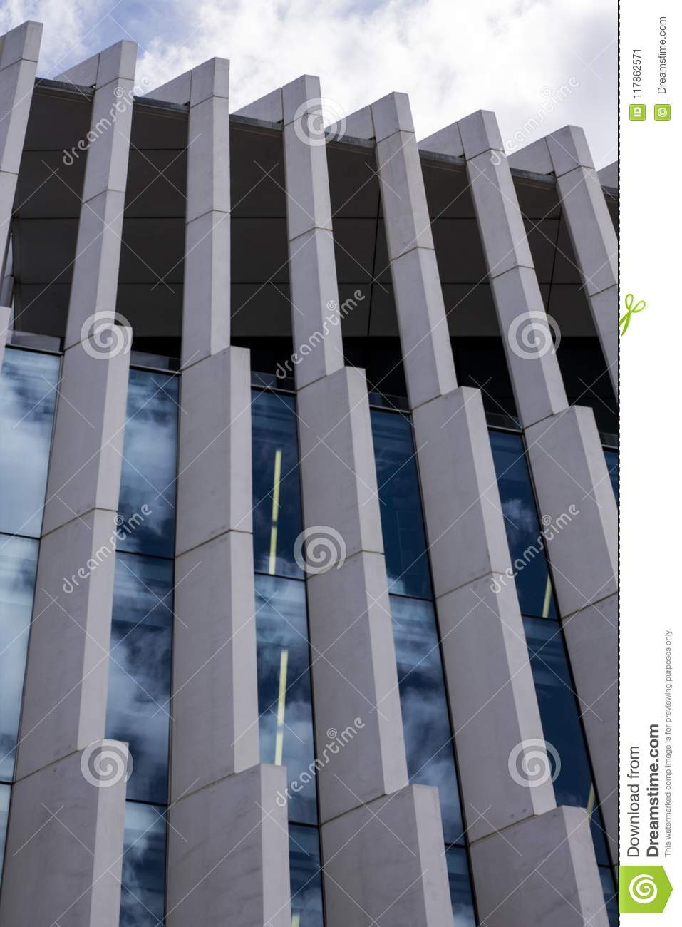 Modern architectural glass structure with reflections