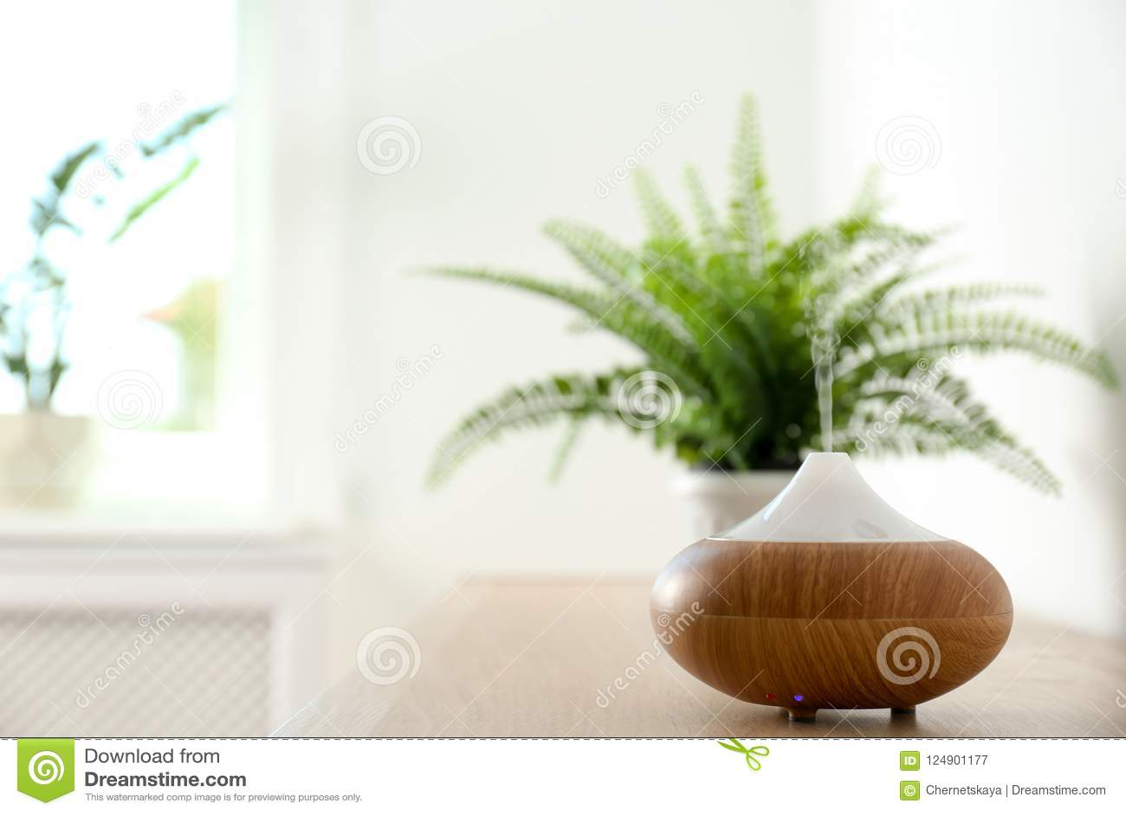 Modern aroma lamp on table