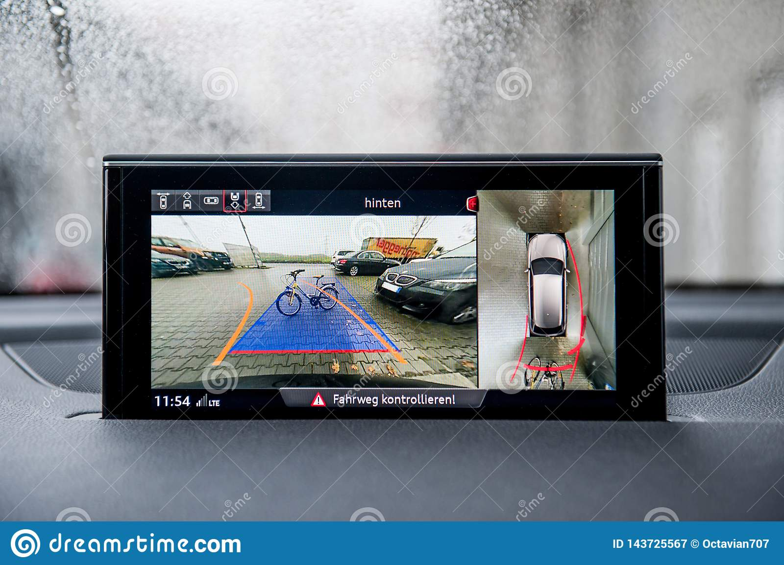 Modern backup camera monitor in car show obstacles