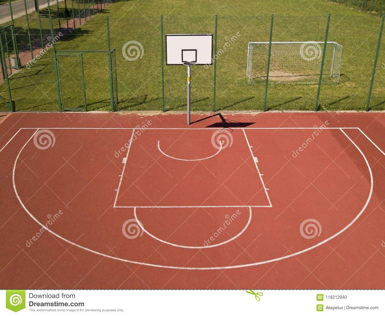 Modern basketball court in the courtyard of primary school. Multifunctional children`s playground with artificial surfaced fenced
