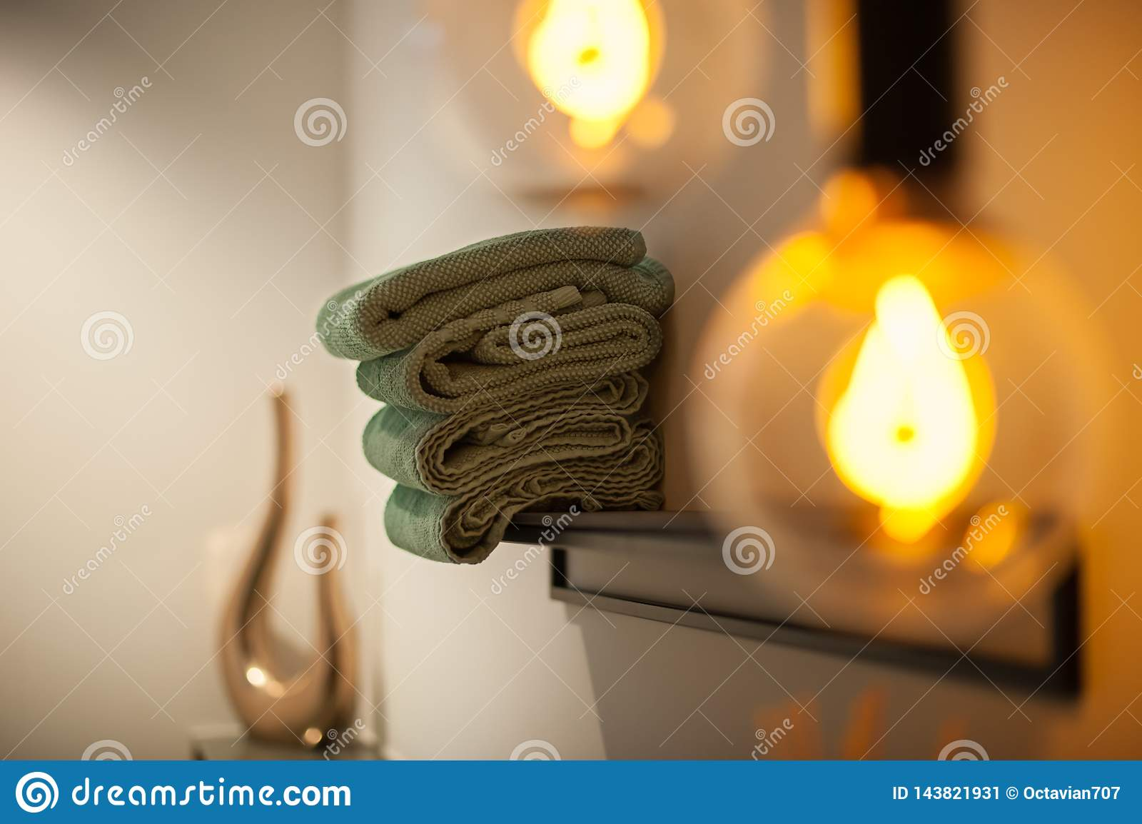 Bath interior with towels and lamp
