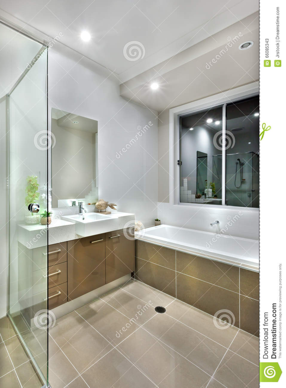 Modern Bathroom With Dark Color Floor Tiles With Lights On Editorial Stock Ph -> Banheiro Moderno Retro