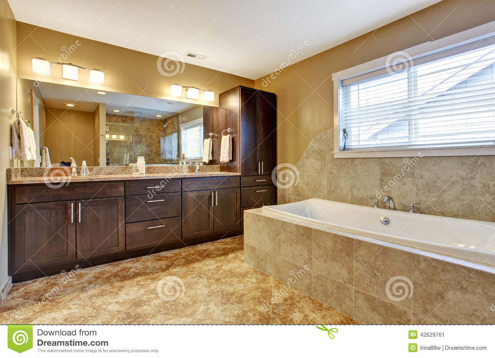 modern bathroom interior with dark brown cabinets stock photo image